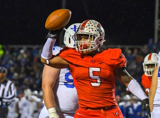 Ivan Pace Jr. of Colerain shows the football after scoring a touchdown against St. X in the OHSAA DI Region 4 Playoffs at Colerain High School,  Friday Nov. 2, 2018