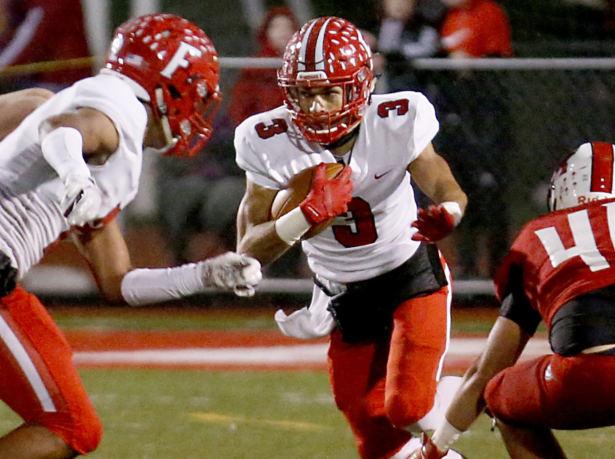 Fairfield wide receiver Peyton Brown looks for a lane against Milford during their Division I playoff game at Eagle Stadium in Milford Friday, Nov. 2, 2018.
