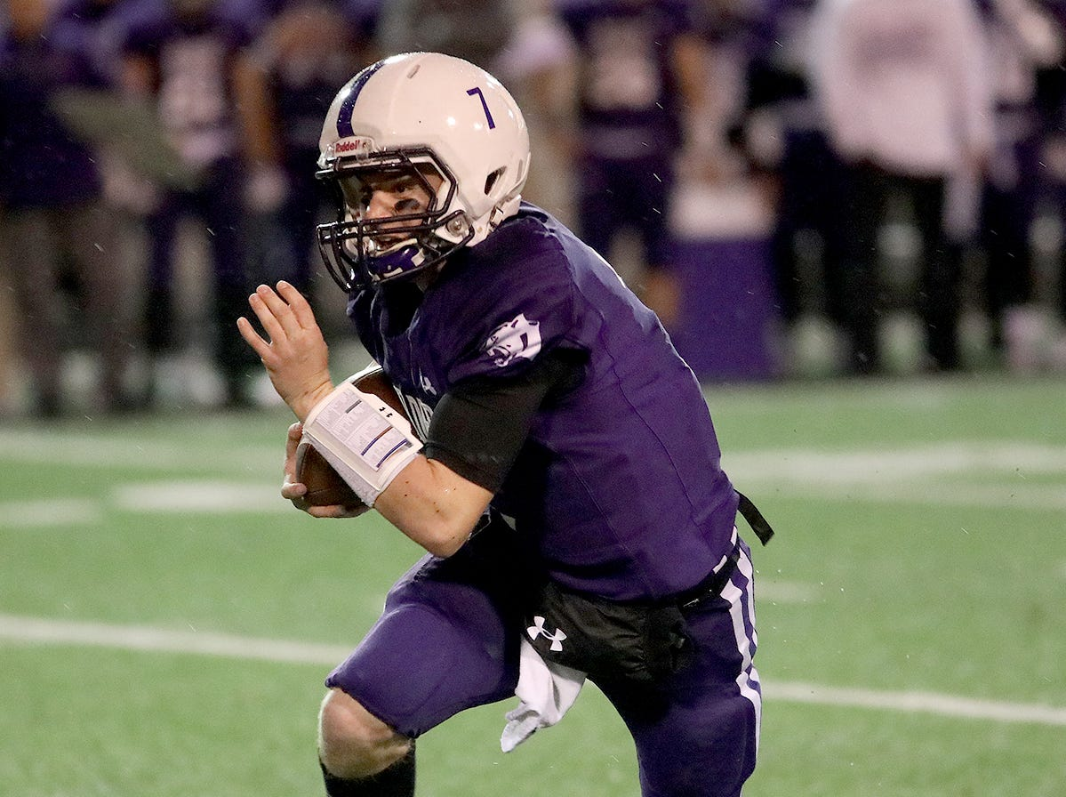 Elder quarterback Matthew Luebbe runs the ball during the Panthers' playoff game against Moeller, Friday, Nov. 2, 2018.