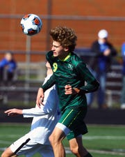 Stephen Colette of McNicholas heads the ball up the field for the Rockets.