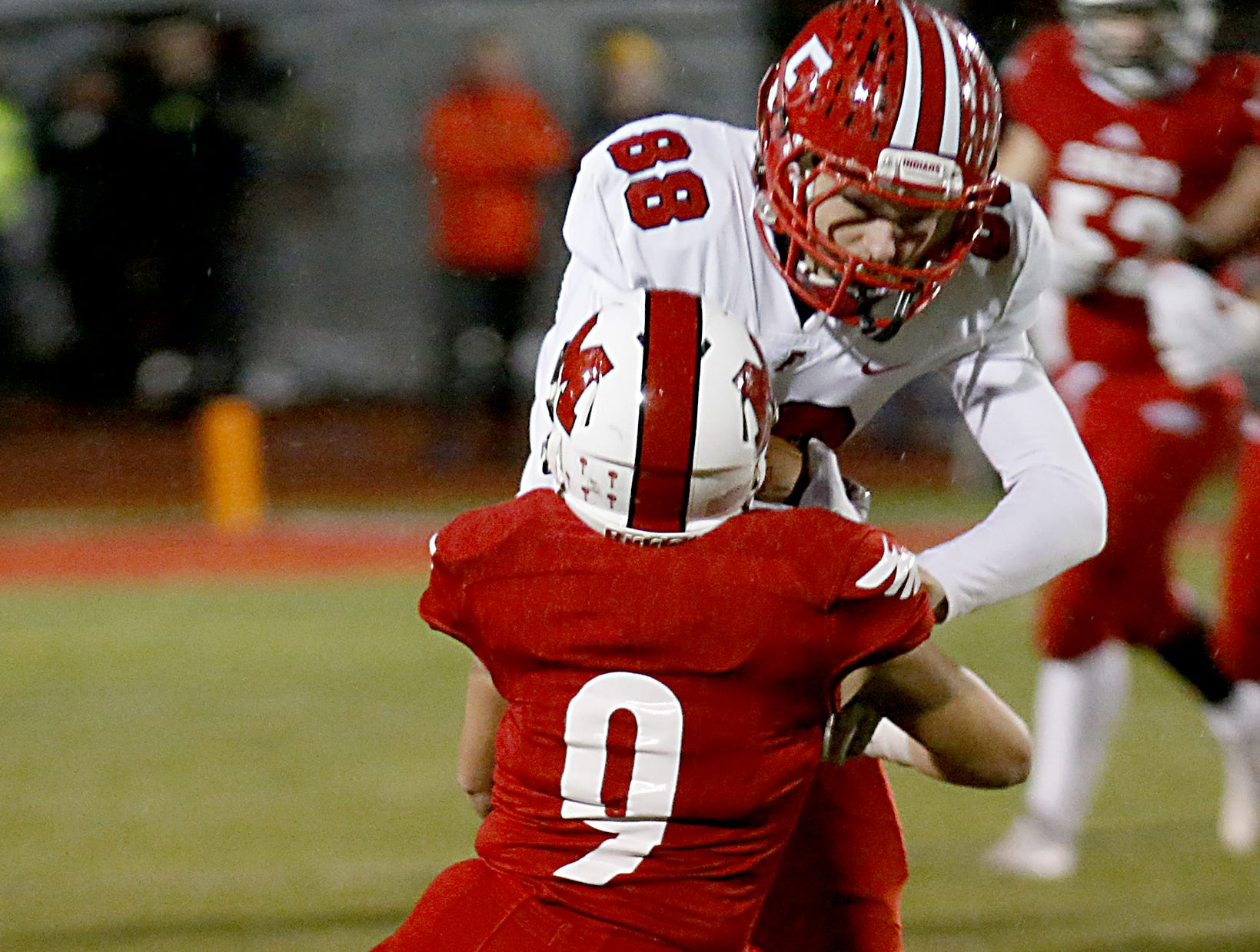 Fairfield tight end Caleb Sexton is stopped by Milford defensive back Owen Martin during their Division I playoff game at Eagle Stadium in Milford Friday, Nov. 2, 2018.