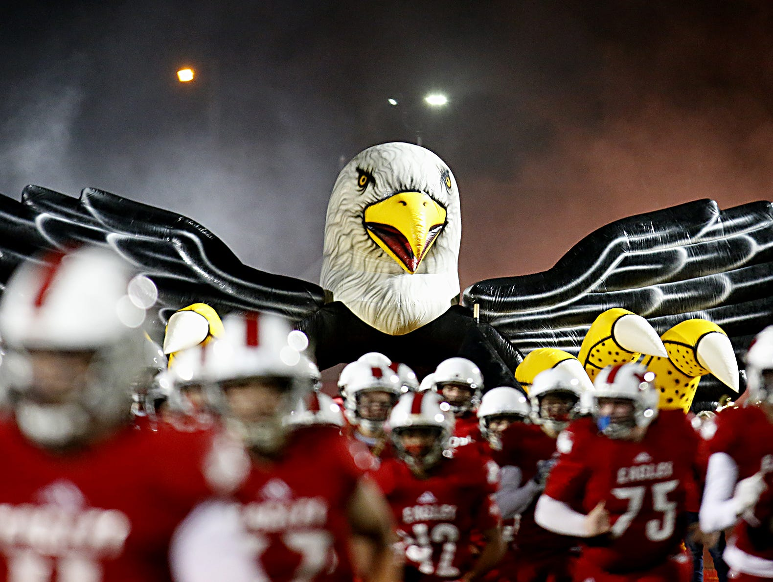 The Milford Eagles take the field for their Division I playoff game against Fairfield at Eagle Stadium in Milford Friday, Nov. 2, 2018.