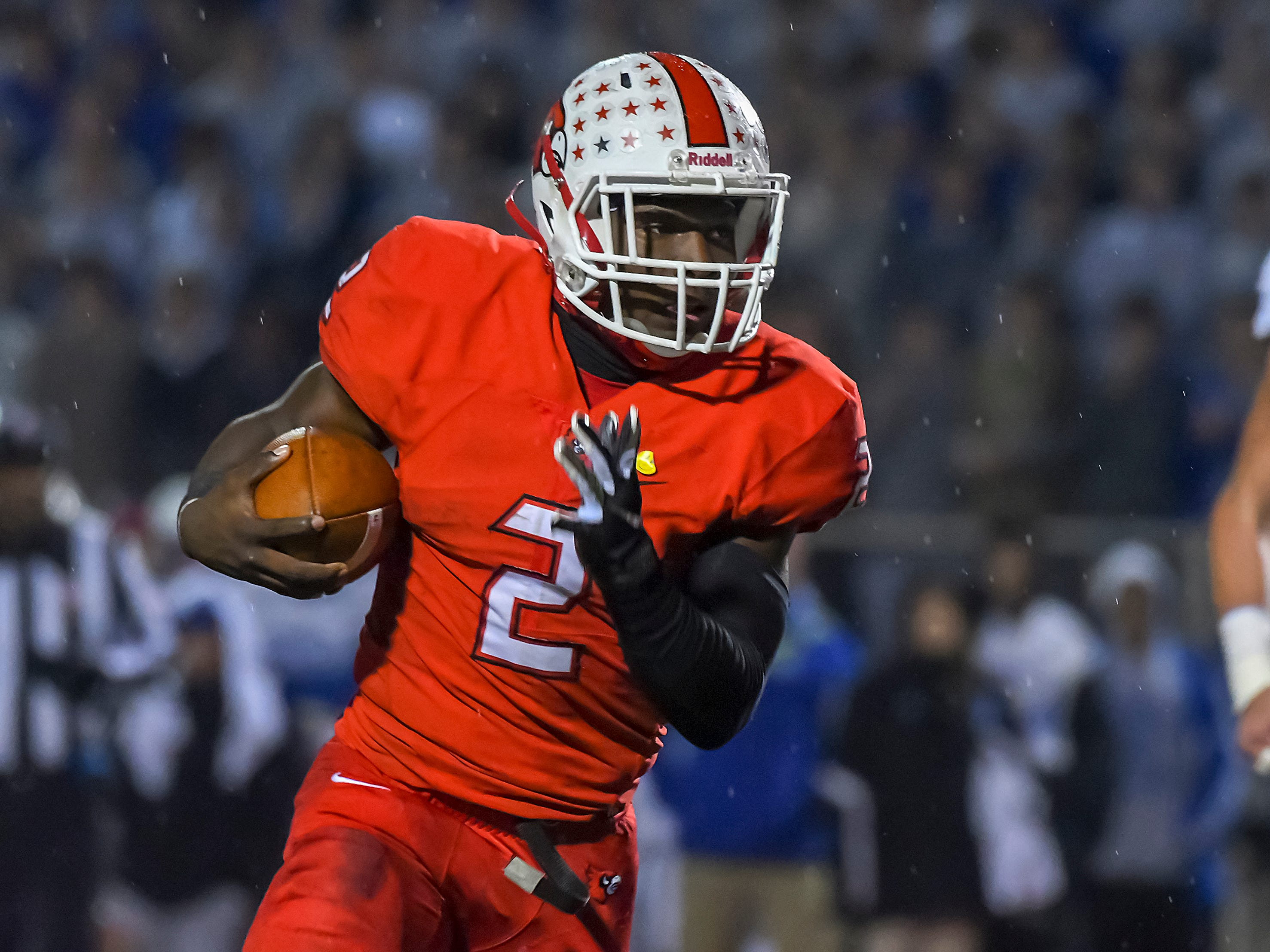 Deante Smith-Moore of Colerain runs the football against St. X in the OHSAA DI Region 4 Playoffs at Colerain High School,  Friday Nov. 2, 2018