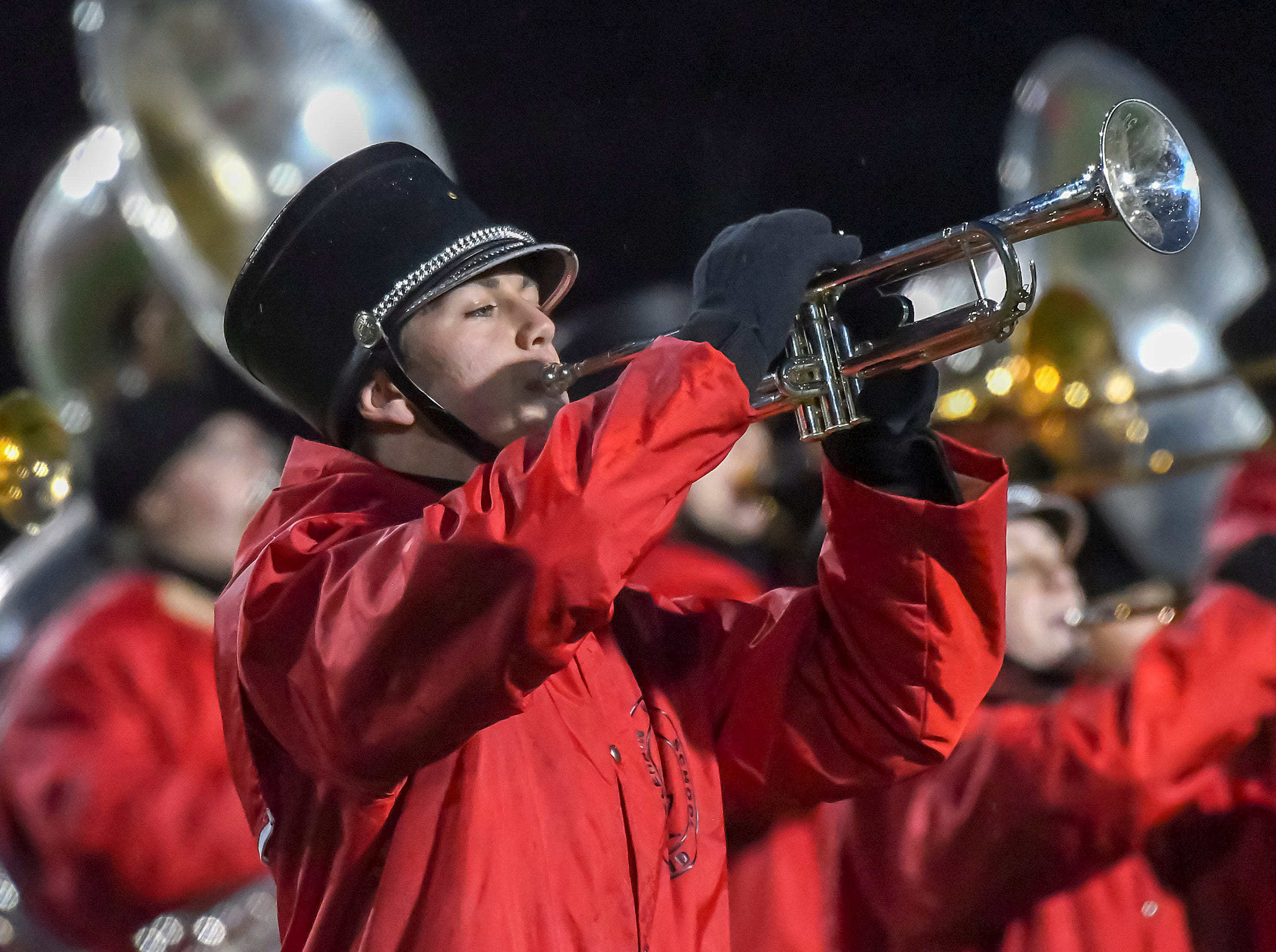 A Colerain band member plays the National Athem before the game in the OHSAA DI Region 4 Playoffs at Colerain High School,  Friday Nov. 2, 2018
