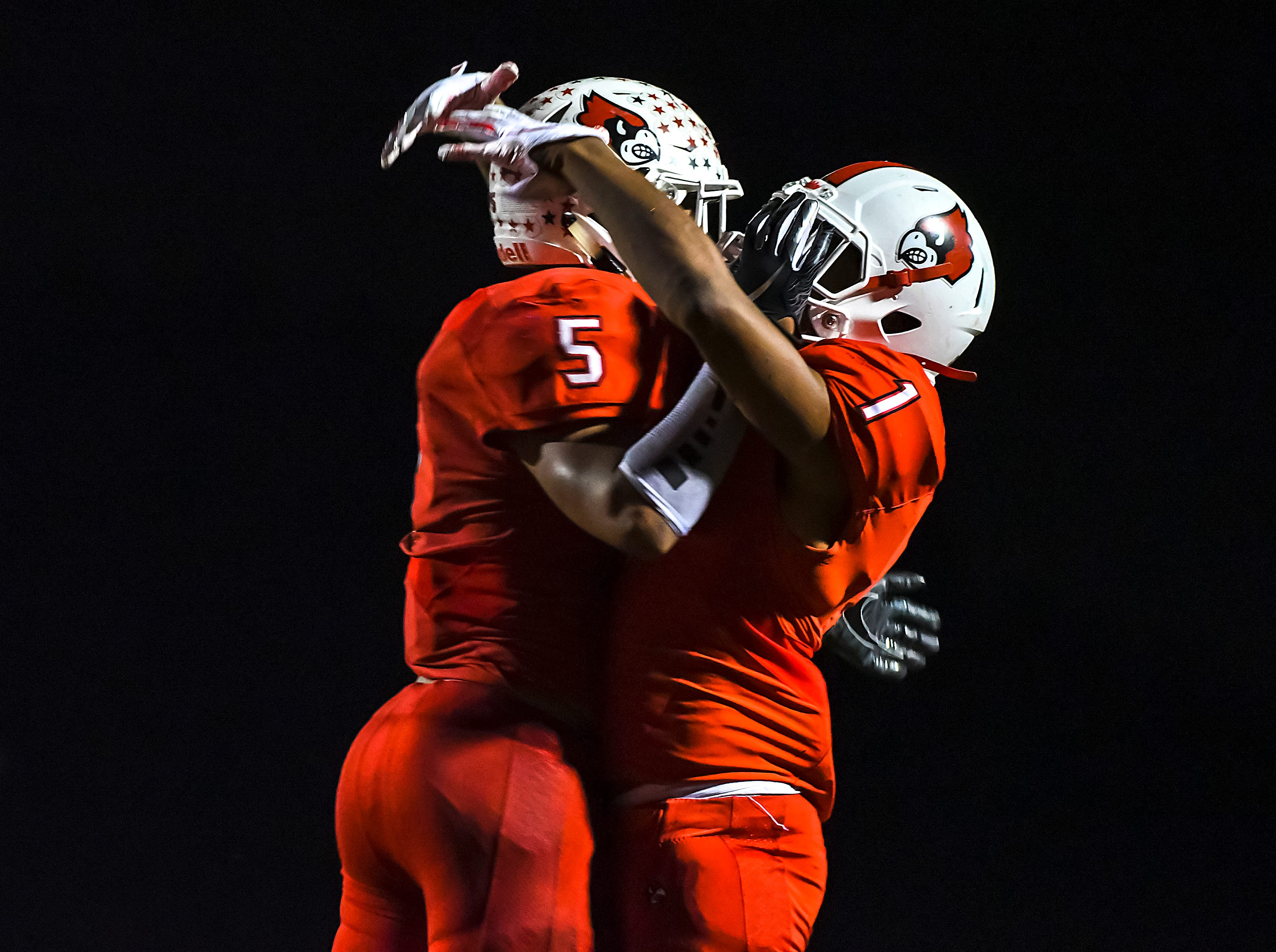 Ivan Pace Jr. (5) and Syncere Jones (1) of Colerain celebrate after a touchdown against St. X in the OHSAA DI Region 4 Playoffs at Colerain High School,  Friday Nov. 2, 2018