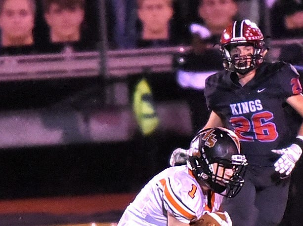 Anderson's Joey Newton takes a completed pass past midfield for a Redskins first down in the Division 2 Region quarterfinal playoff game, November 2, 2018.