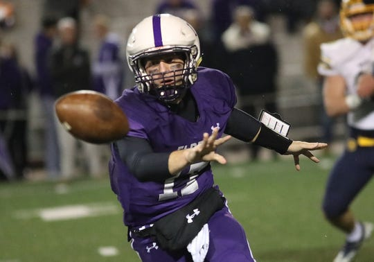 Elder quarterback Micheal Bittner pitches the ball during the Panthers' playoff game against Moeller, Friday, Nov. 2, 2018.