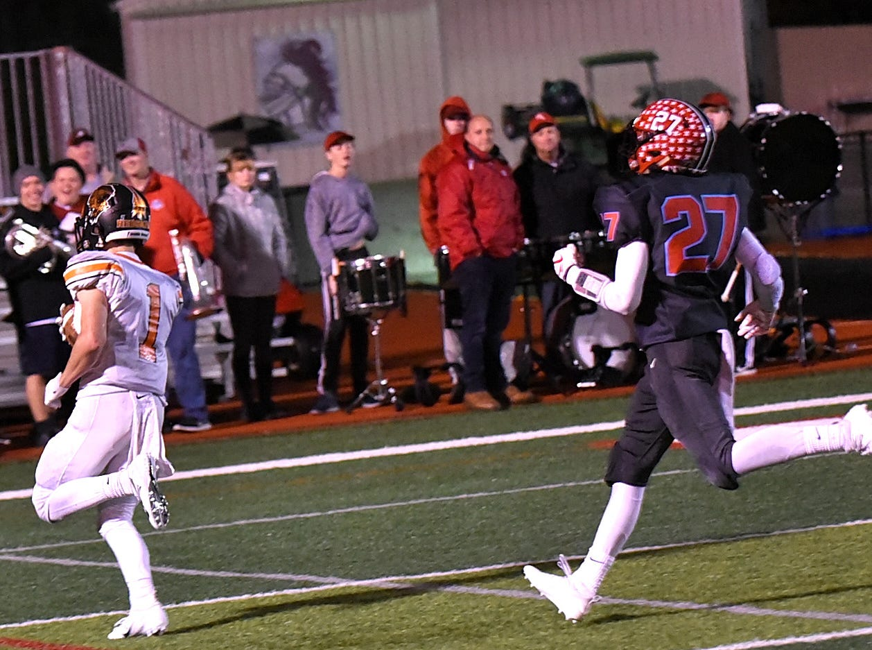 Jay Cheatham of Kings gives chase but cannot catch Joey Newton (1) of Anderson before he crosses the goal line for the Redskins in the Division 2 Region quarterfinal playoff game, November 2, 2018.