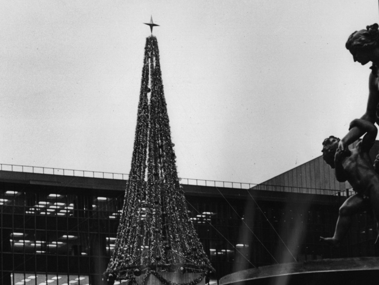 1971: A new 50-foot Christmas tree towers over passersby at Fountain Square Plaza. The tree, a donation from Procter & Gamble Co., has 2000 multicolored lights to blend with the lights which will be placed on the 20 live trees on the square.
