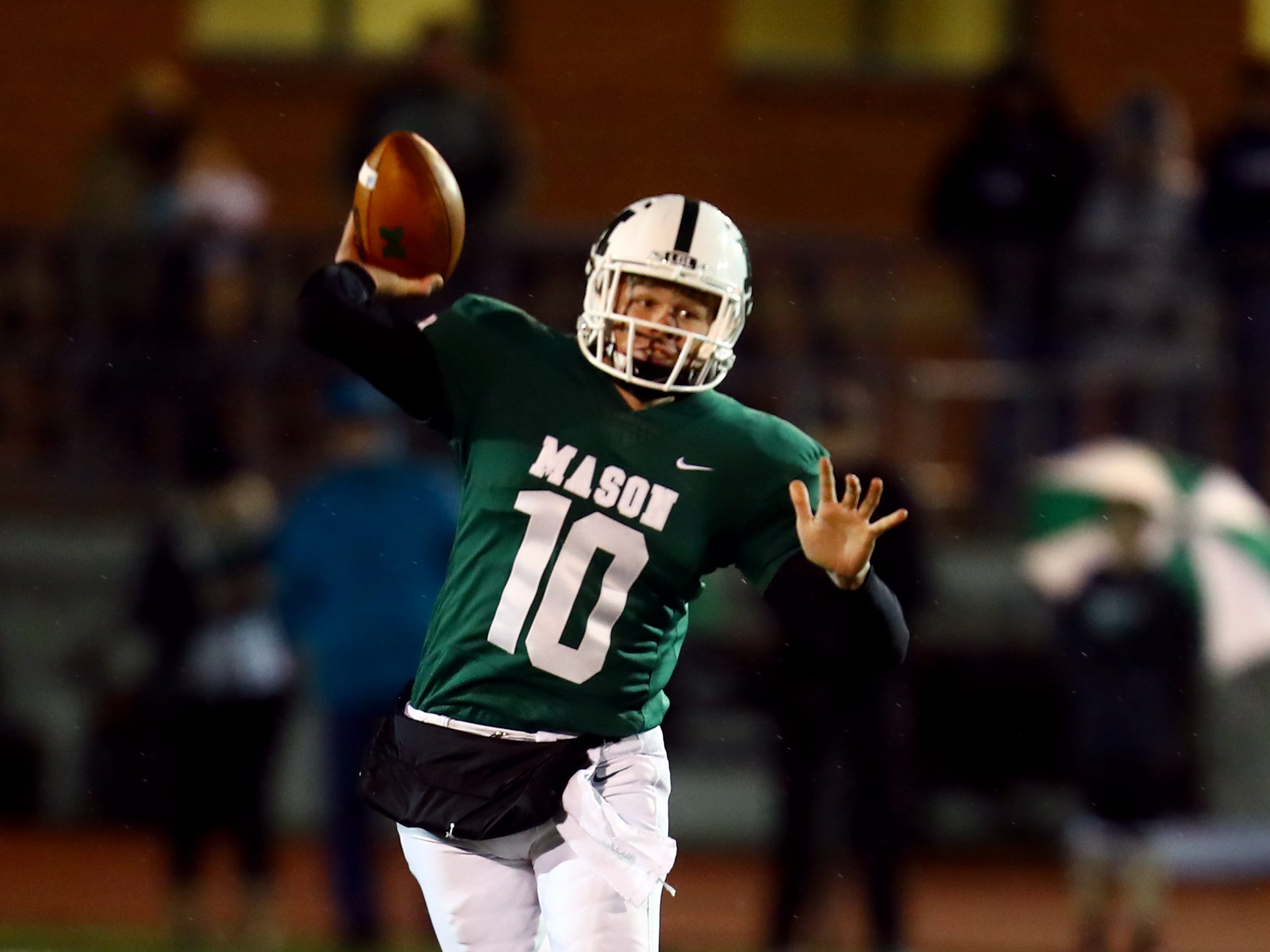 Mason quarterback Collin Brown attempts a pass the in game between the Lakota East Thunderhawks and the Mason Comets Nov. 2.