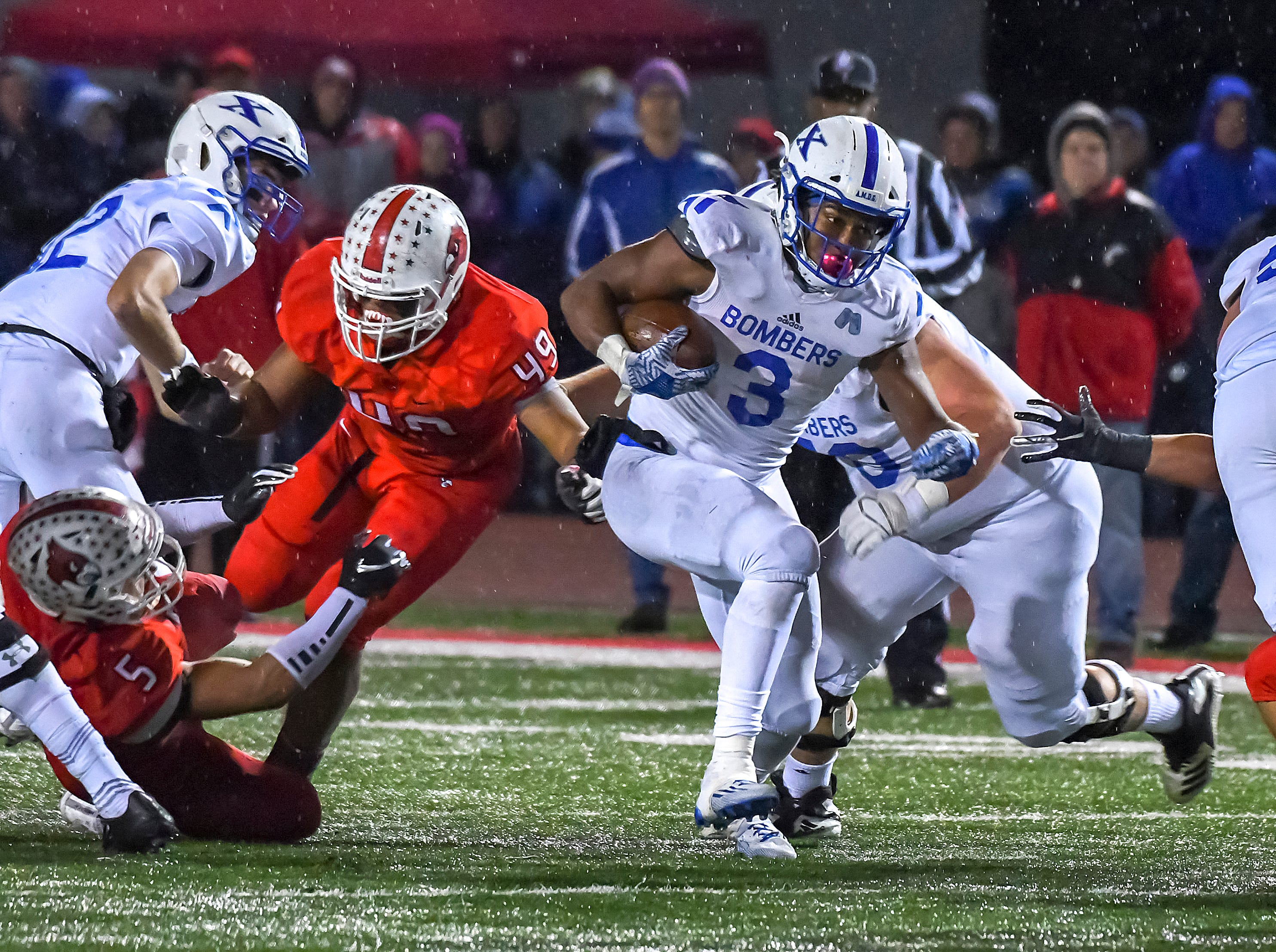 Running back Chris Payne of St. X runs the ball against Colerain in the OHSAA DI Region 4 Playoffs at Colerain High School,  Friday Nov. 2, 2018