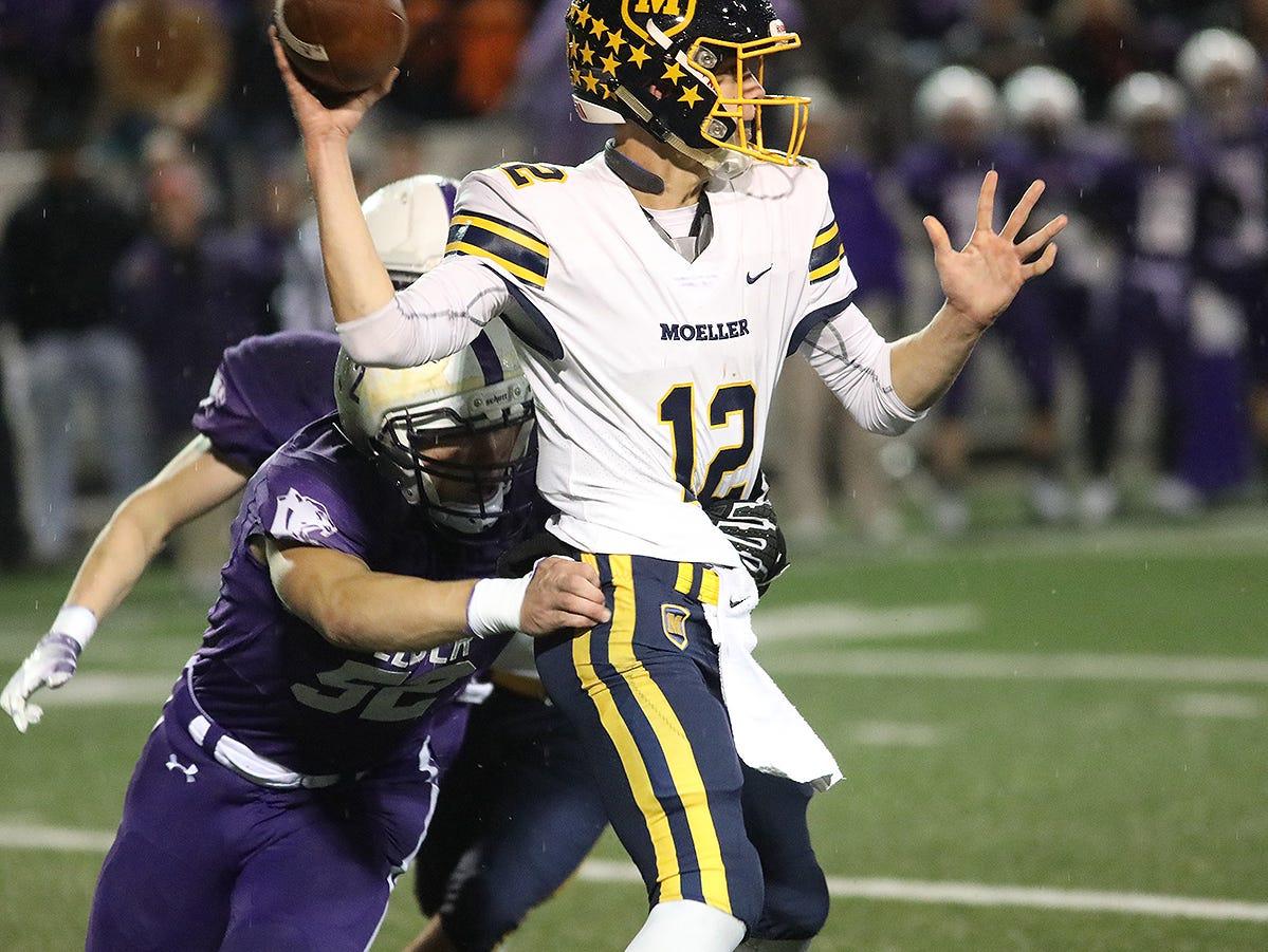 Elder defensive end Spencer Bono (52) pressures Moeller quarterback Mitch McKenzie (12) during the Panthers 35-0 playoff  win over Moeller, Friday, Nov. 2, 2018.