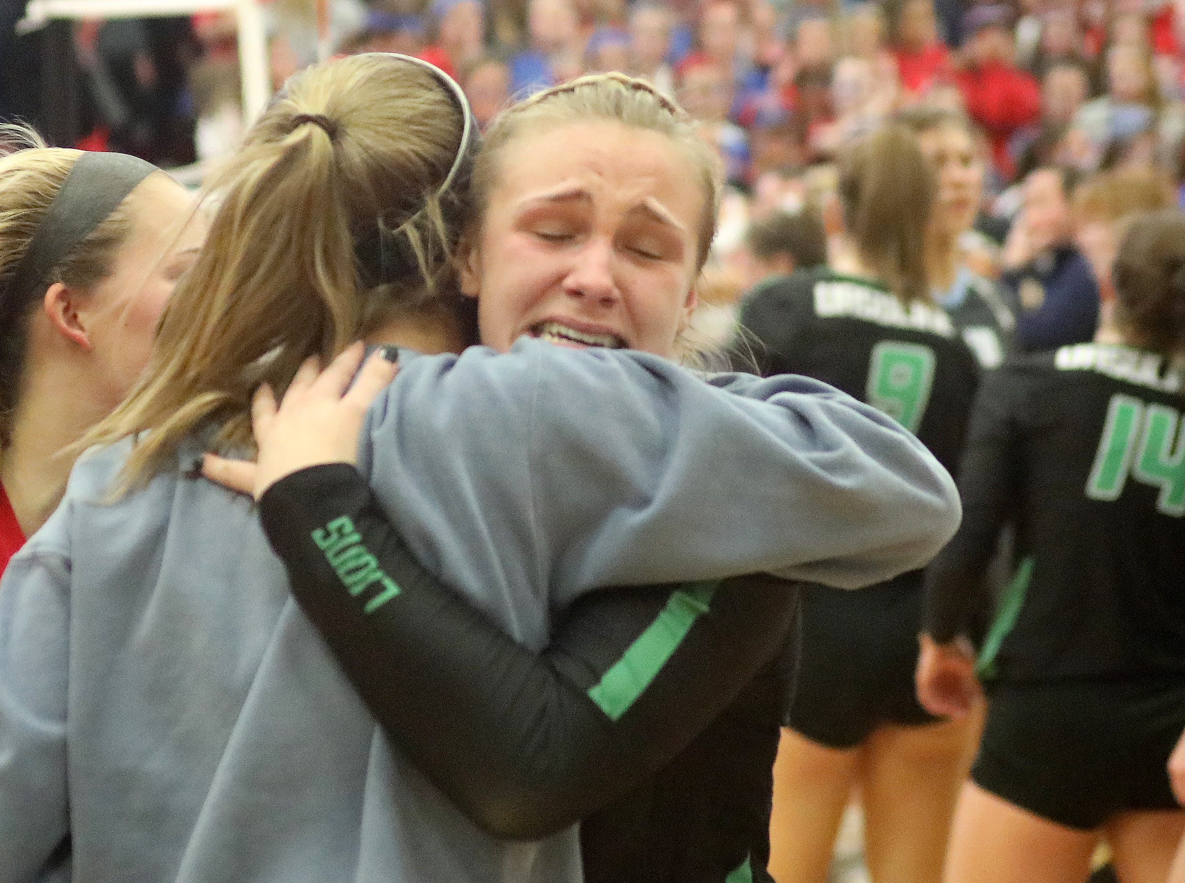 Ursuline players celebrate after the Lions win the regional championship, Saturday, Nov. 3,2018.