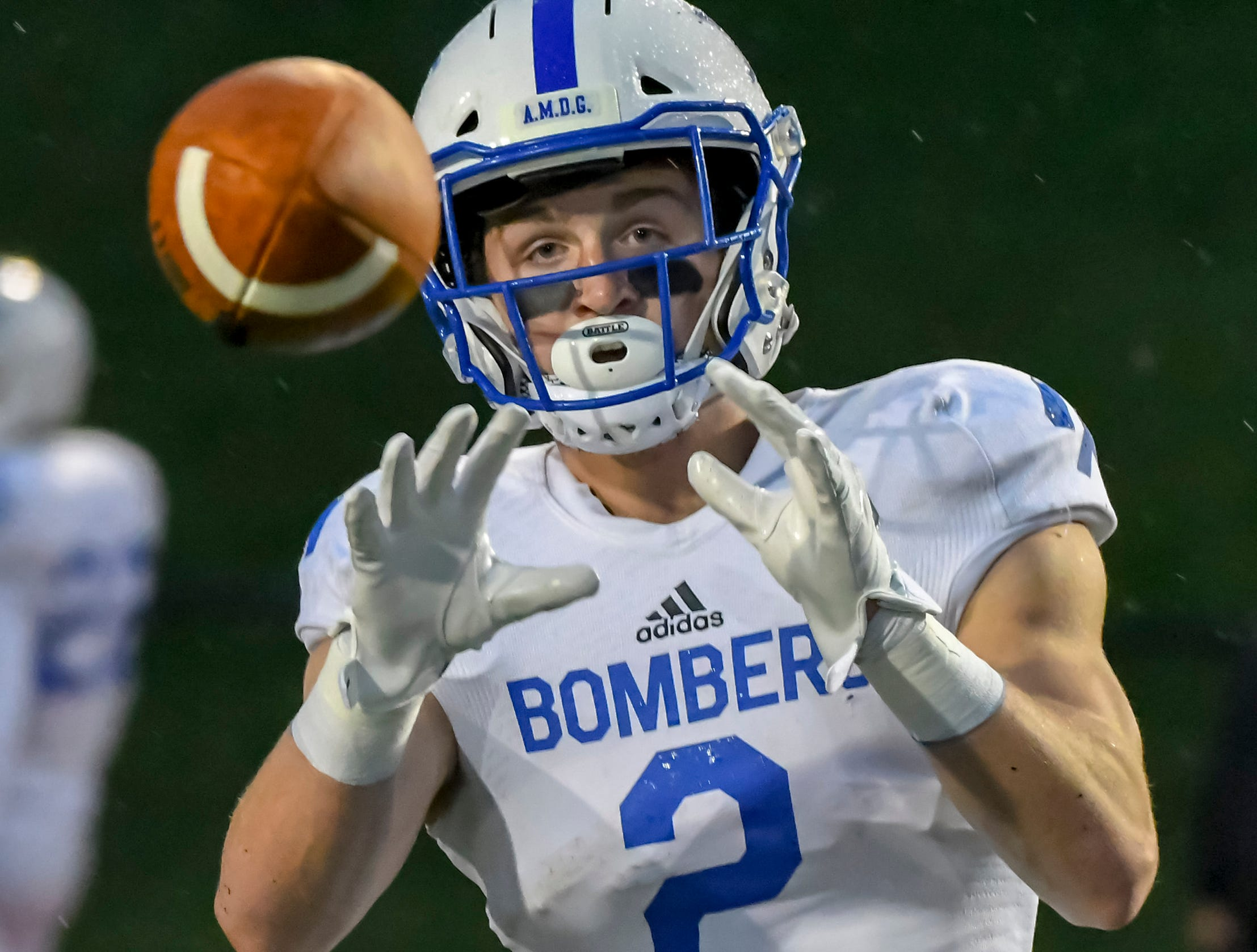 St. X receiver Liam Clifford receives a pass during warm ups before the game against Colerain in the OHSAA DI Region 4 Playoffs at Colerain High School,  Friday Nov. 2, 2018