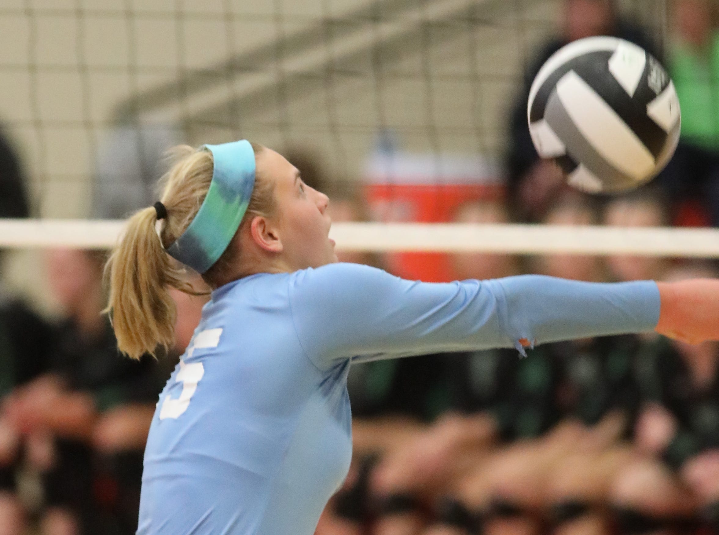 Mount Notre Dame player Stevie Wolf bumps the ball during the Cougars regional championship match against Ursuline , Saturday, Nov. 3,2018.