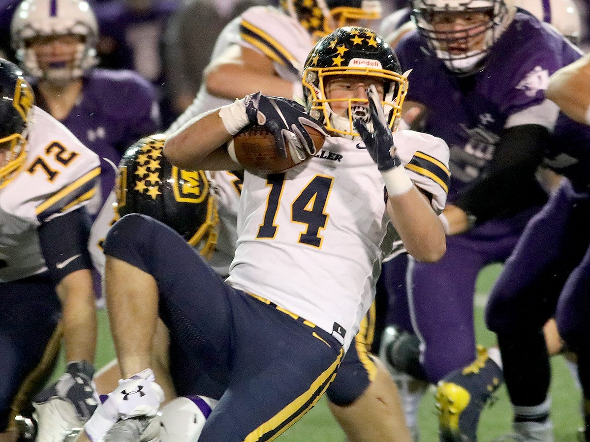 Moeller running back  T.J. Rotello runs the ball during the Crusaders' playoff game against Elder, Friday, Nov. 2, 2018.