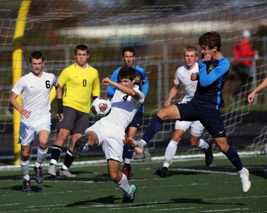 Turpin forward Max Murphy clears the ball out from in front of the Spartans goal against Moeller in the Division I regional final Nov. 3.