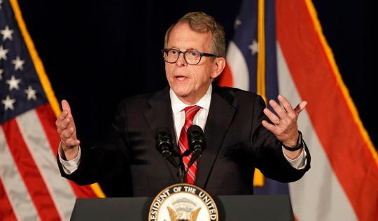 Republican gubernatorial candidate Mike DeWine speaks at the Mansfield Lahm Regional Airport, Wednesday, Oct. 31, 2018, in Mansfield, Ohio. (AP Photo/Tony Dejak)