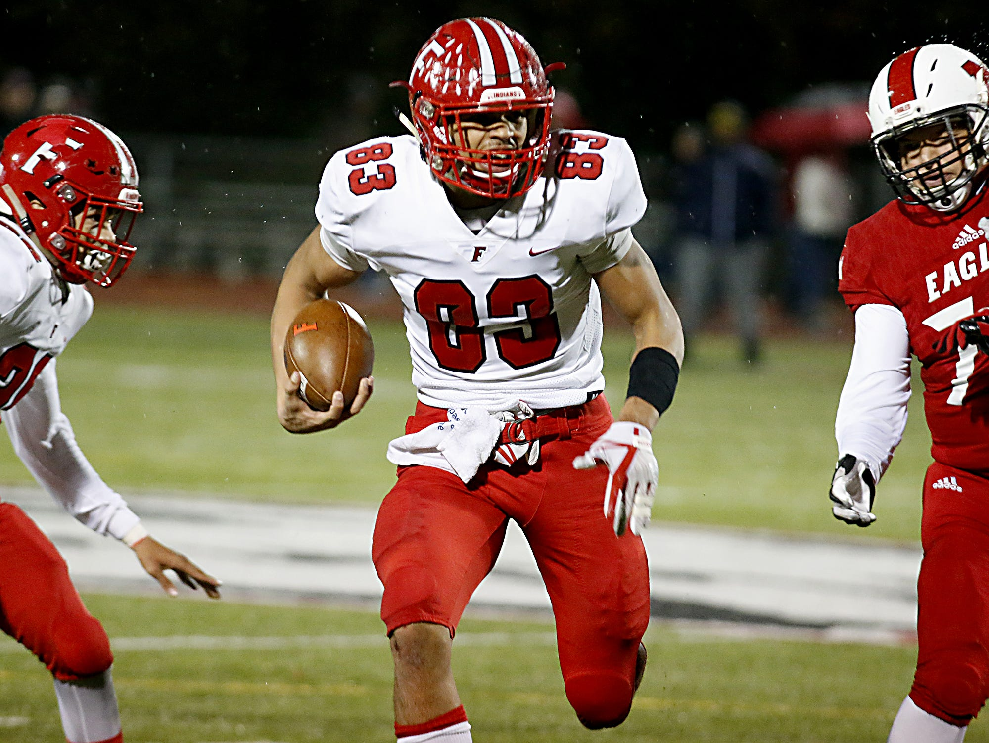 Fairfield's Erick All runs for a touchdown against Milford during their Division I playoff game at Eagle Stadium in Milford Friday, Nov. 2, 2018.