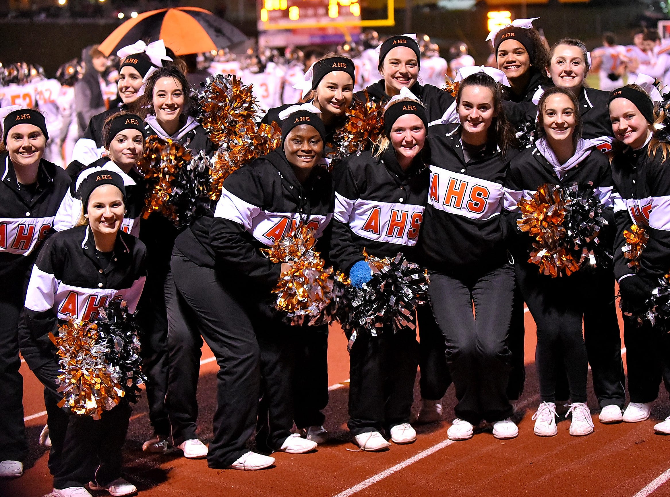 The Anderson Redskins cheerleaders celebrate the 42-35 win in the Division 2 Region quarterfinal playoff game, November 2, 2018.