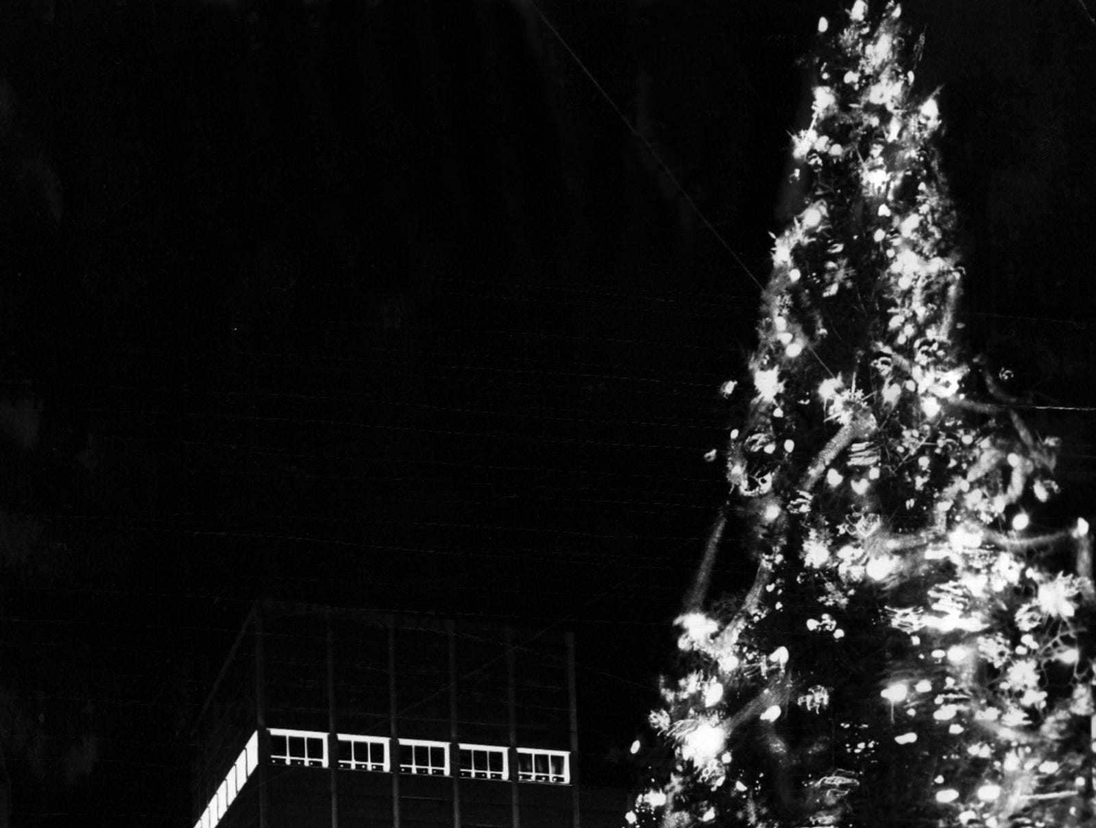 1962: Thousands of Greater Cincinnatians thronged the adjoining intersections to welcome the Christmas tree's arrival to Fountain Square. They began gathering shortly after 8 p.m. spilling out of stores, off buses, from automobiles.