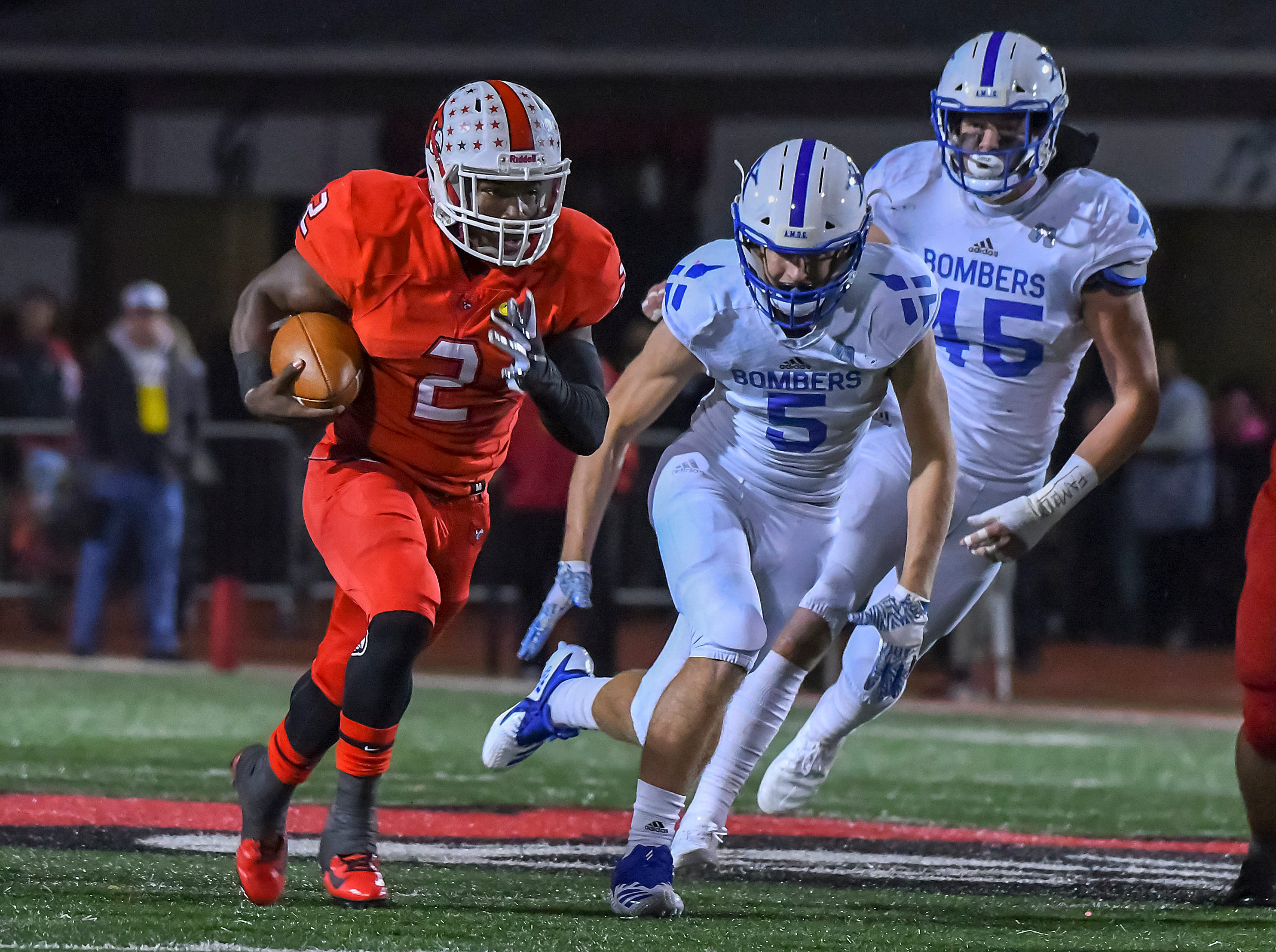 Deante Smith-Moore (2) of Colerain runs the football against St. X in the OHSAA DI Region 4 Playoffs at Colerain High School,  Friday Nov. 2, 2018