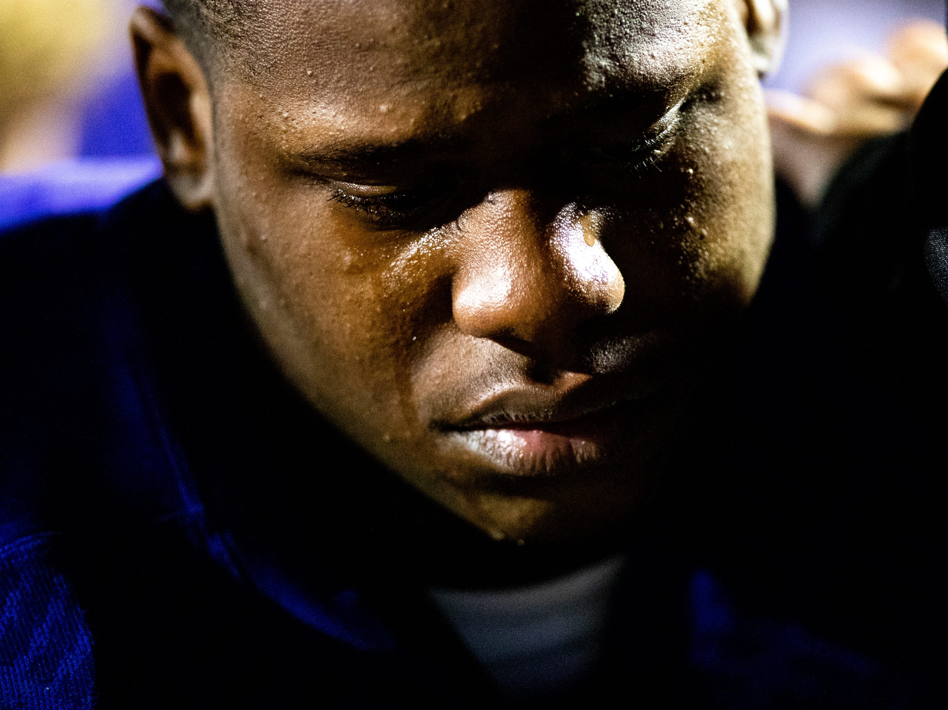 Taeshawn Deal (68) of Clarksville High cries next to his teammates after losing in overtime at Clarksville High Friday, Nov. 2, 2018, in Clarksville, Tenn.