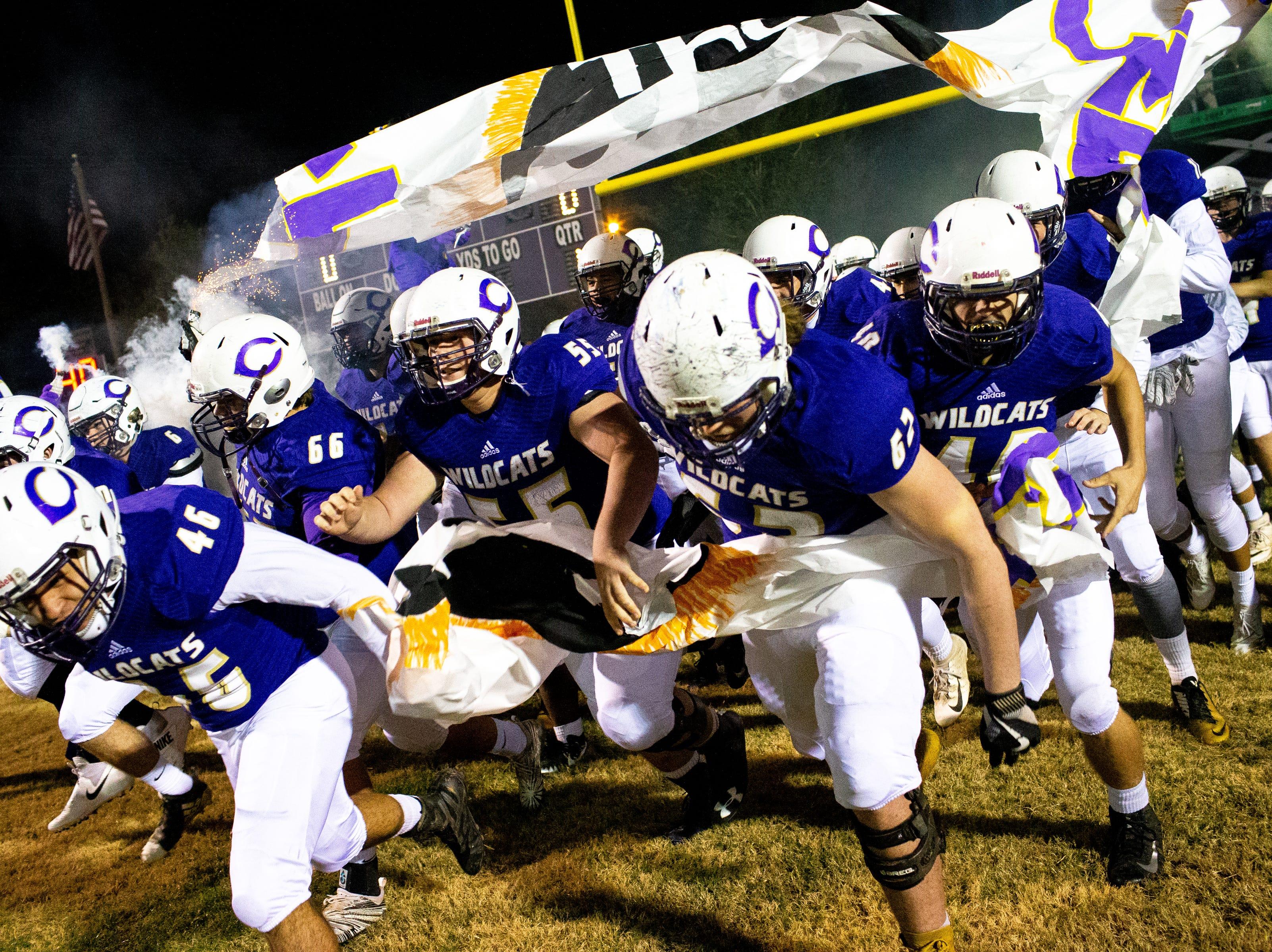 Clarksville High runs onto the field before the game at Clarksville High Friday, Nov. 2, 2018, in Clarksville, Tenn.
