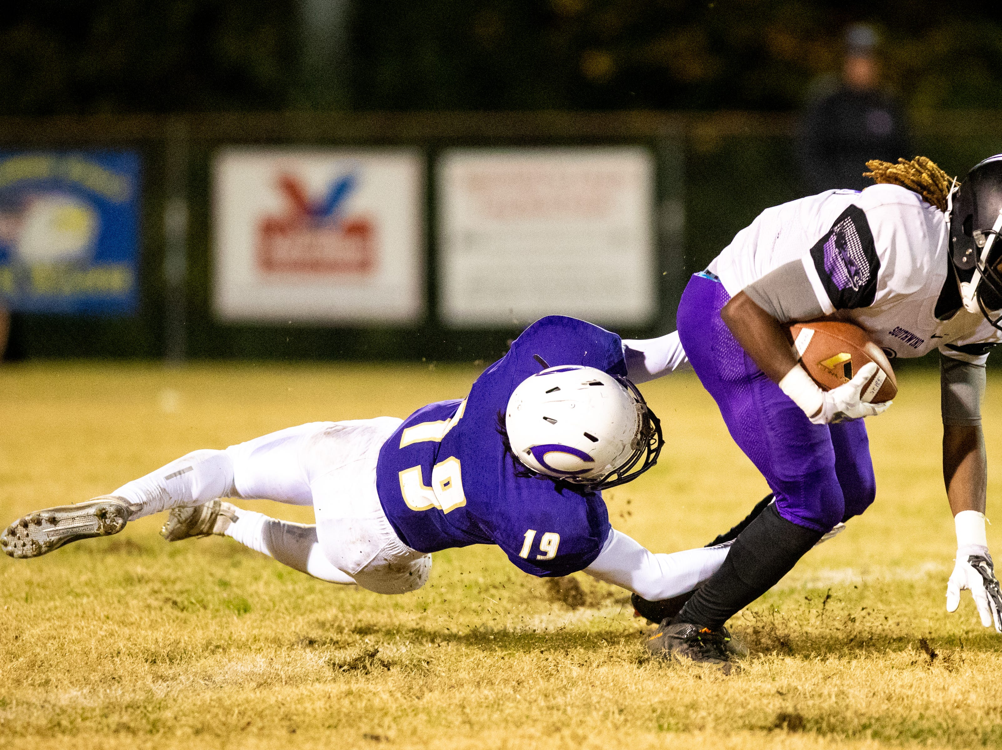 Lakavius Summers (2) of Southwind is tackled by Ethan Ponder (19) of Clarksville High during the first half at Clarksville High Friday, Nov. 2, 2018, in Clarksville, Tenn.