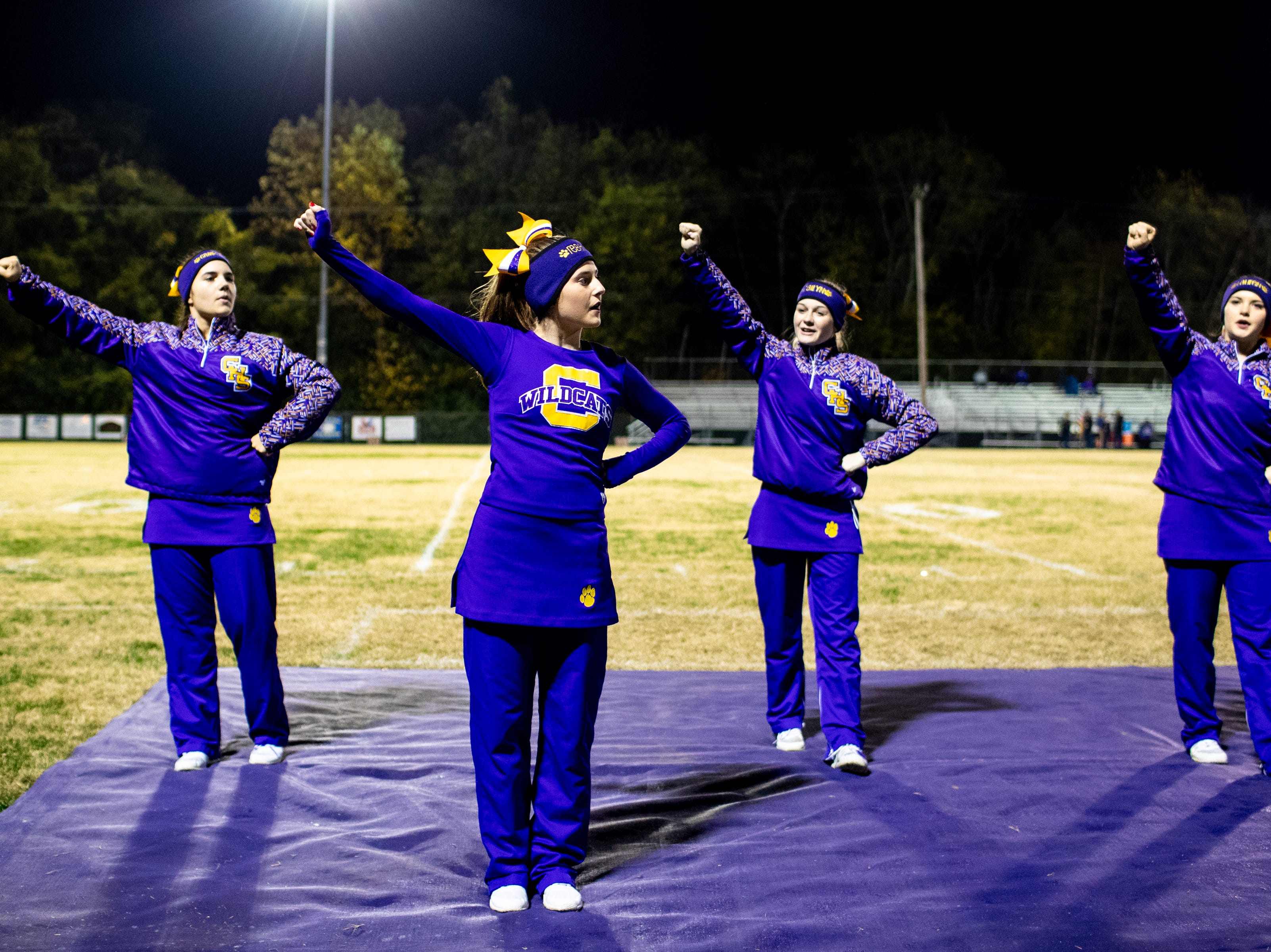 Clarksville High cheerleaders warm up before the game at Clarksville High Friday, Nov. 2, 2018, in Clarksville, Tenn.