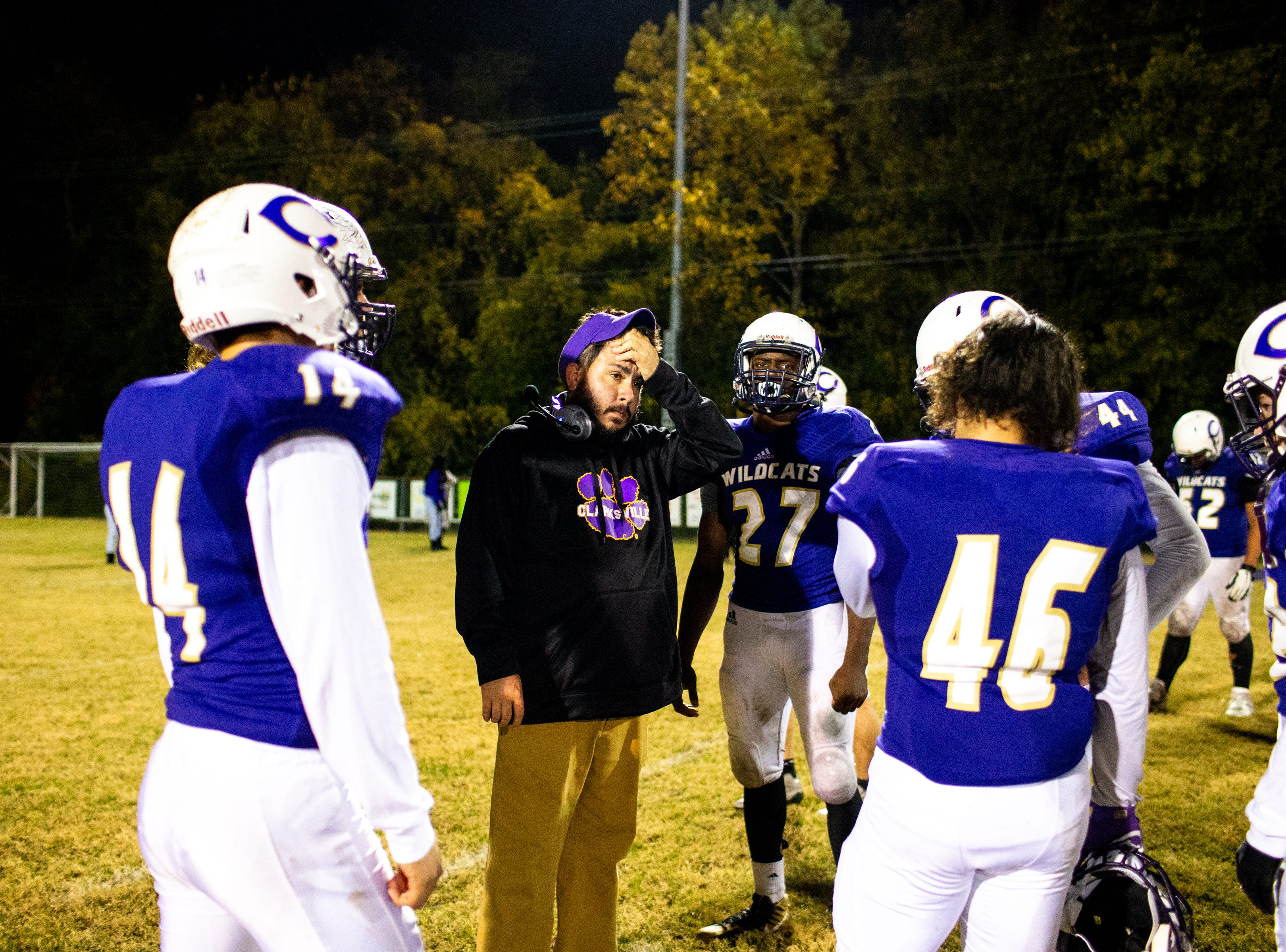 Clarksville High head coach Isaac Shelby gathers the players after losing in overtime at Clarksville High Friday, Nov. 2, 2018, in Clarksville, Tenn.