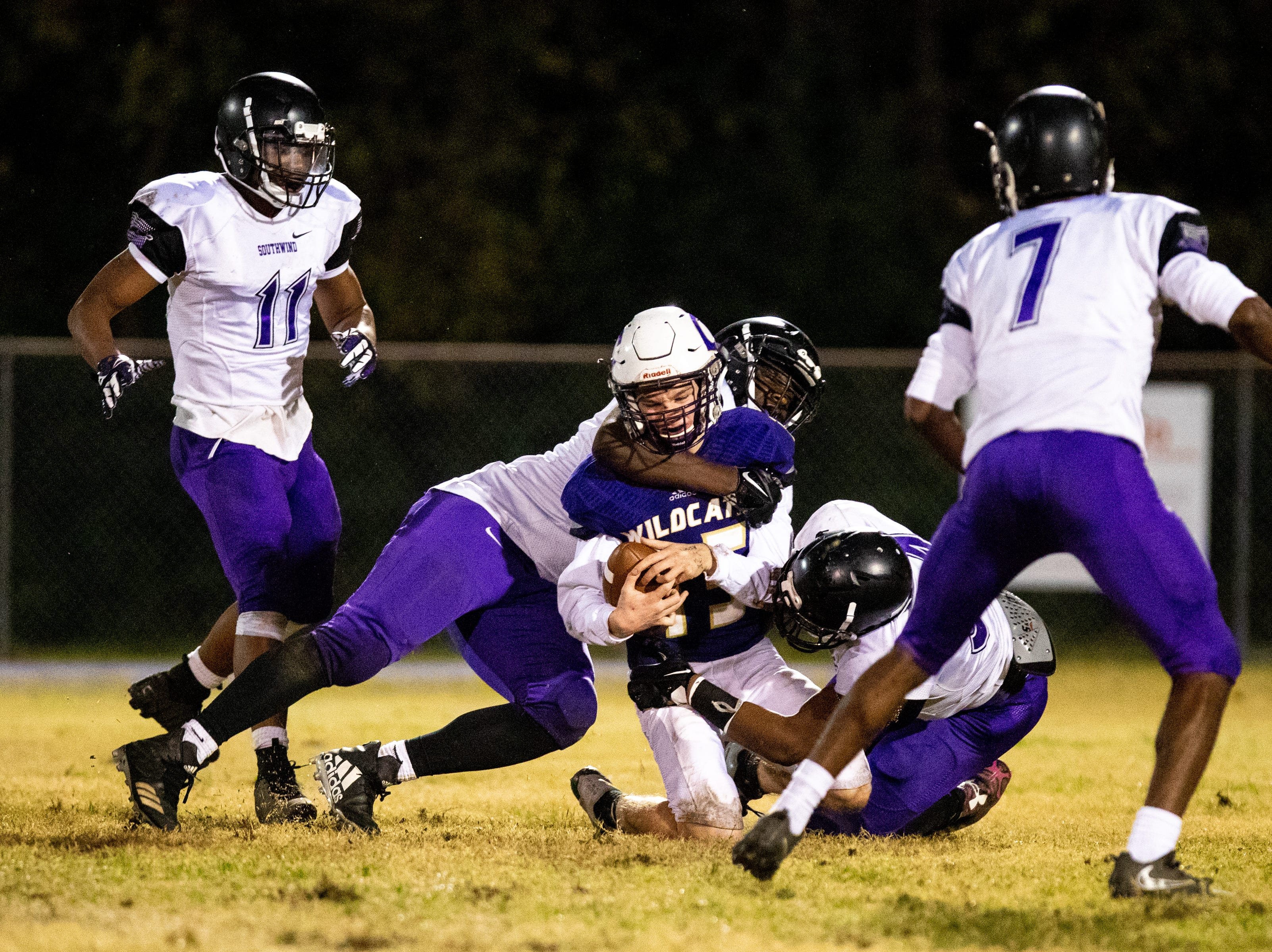 Backup quarterback Colby Cook (15) of Clarksville High is sacked during the first half at Clarksville High Friday, Nov. 2, 2018, in Clarksville, Tenn.