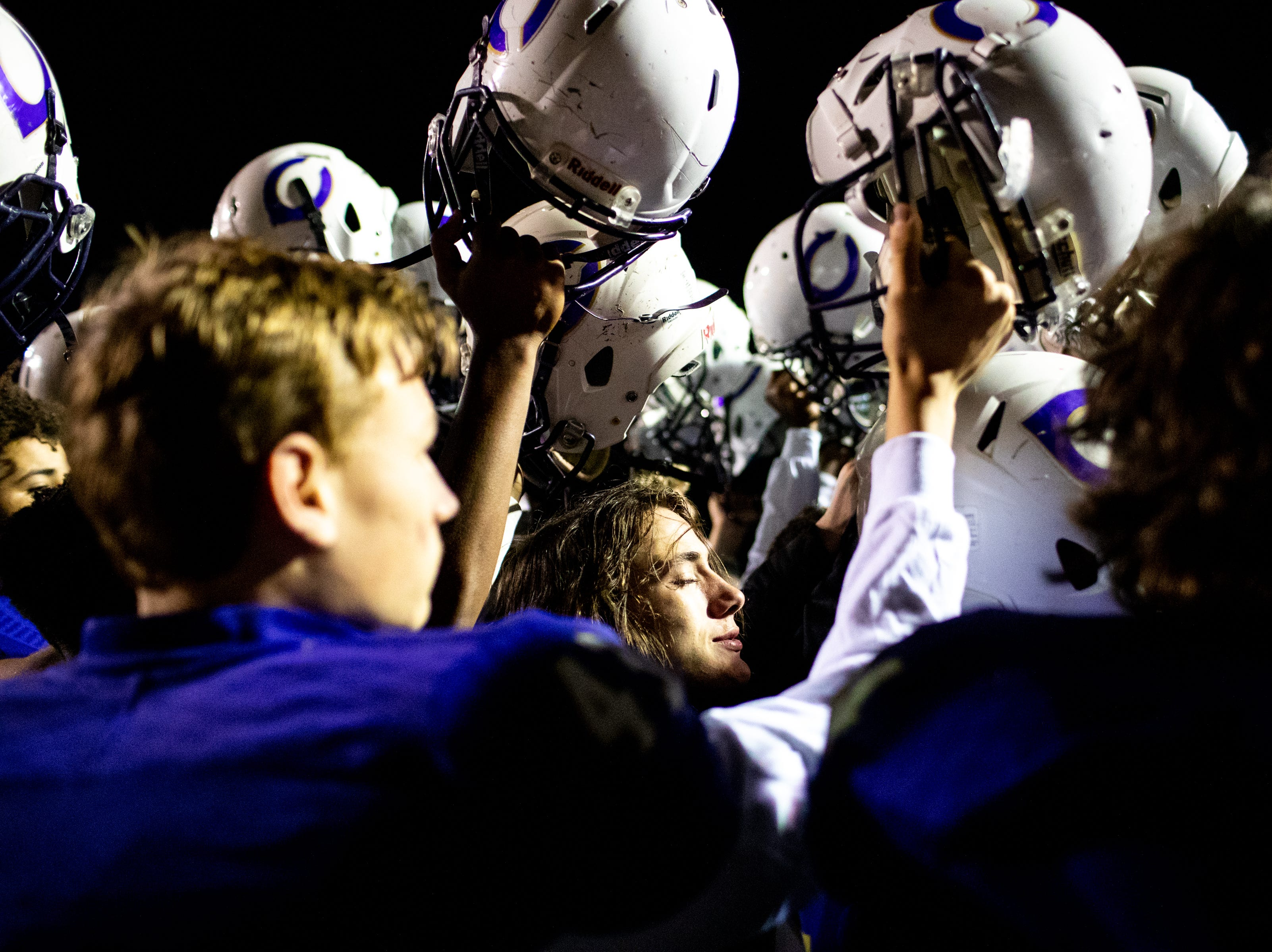 Ethan Ponder (19) lifts up his helmet one last time with his Clarksville High team after losing in overtime at Clarksville High Friday, Nov. 2, 2018, in Clarksville, Tenn.
