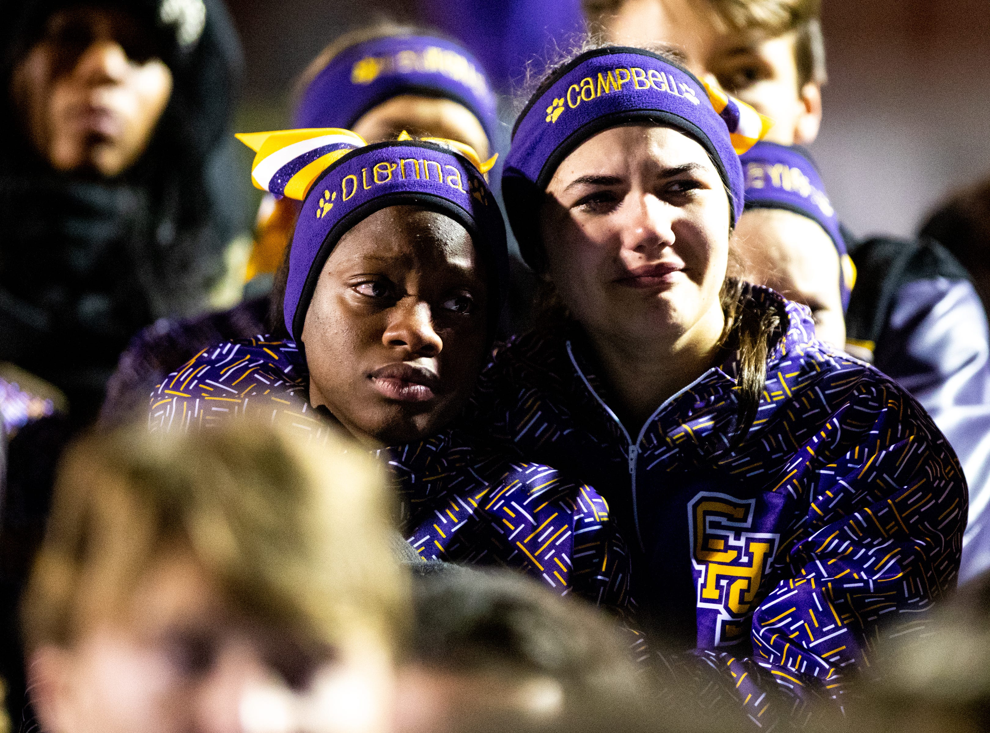 Clarksville cheerleaders comfort each other as they cry and listen to the senior players speak after losing in overtime at Clarksville High Friday, Nov. 2, 2018, in Clarksville, Tenn.