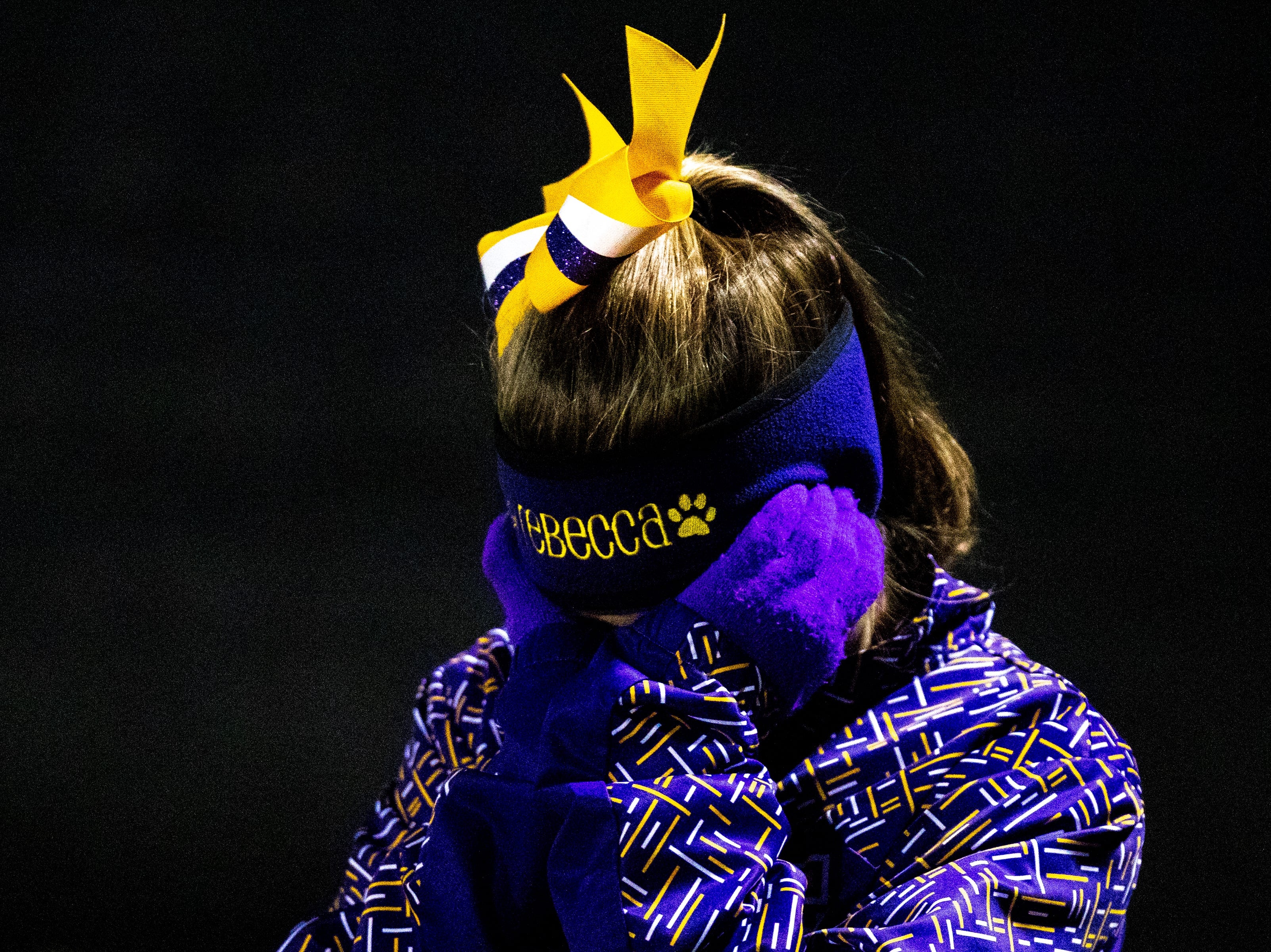 Clarksville High cheerleader Rebecca Bogle covers her face during the second half at Clarksville High Friday, Nov. 2, 2018, in Clarksville, Tenn.