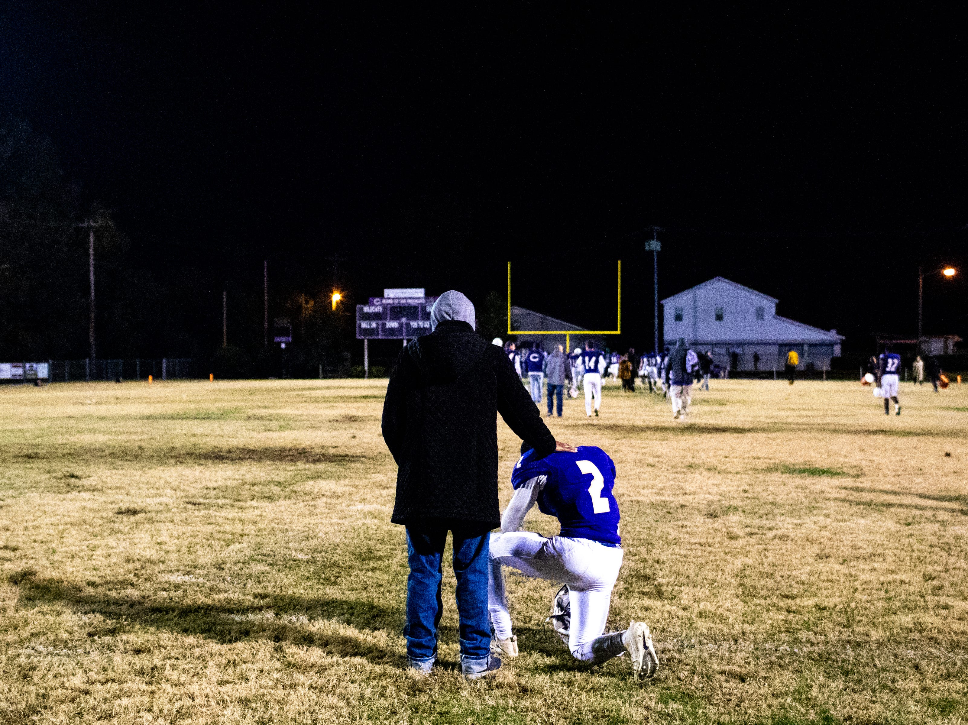 Price Warfield is comforted after losing in overtime at Clarksville High Friday, Nov. 2, 2018, in Clarksville, Tenn.