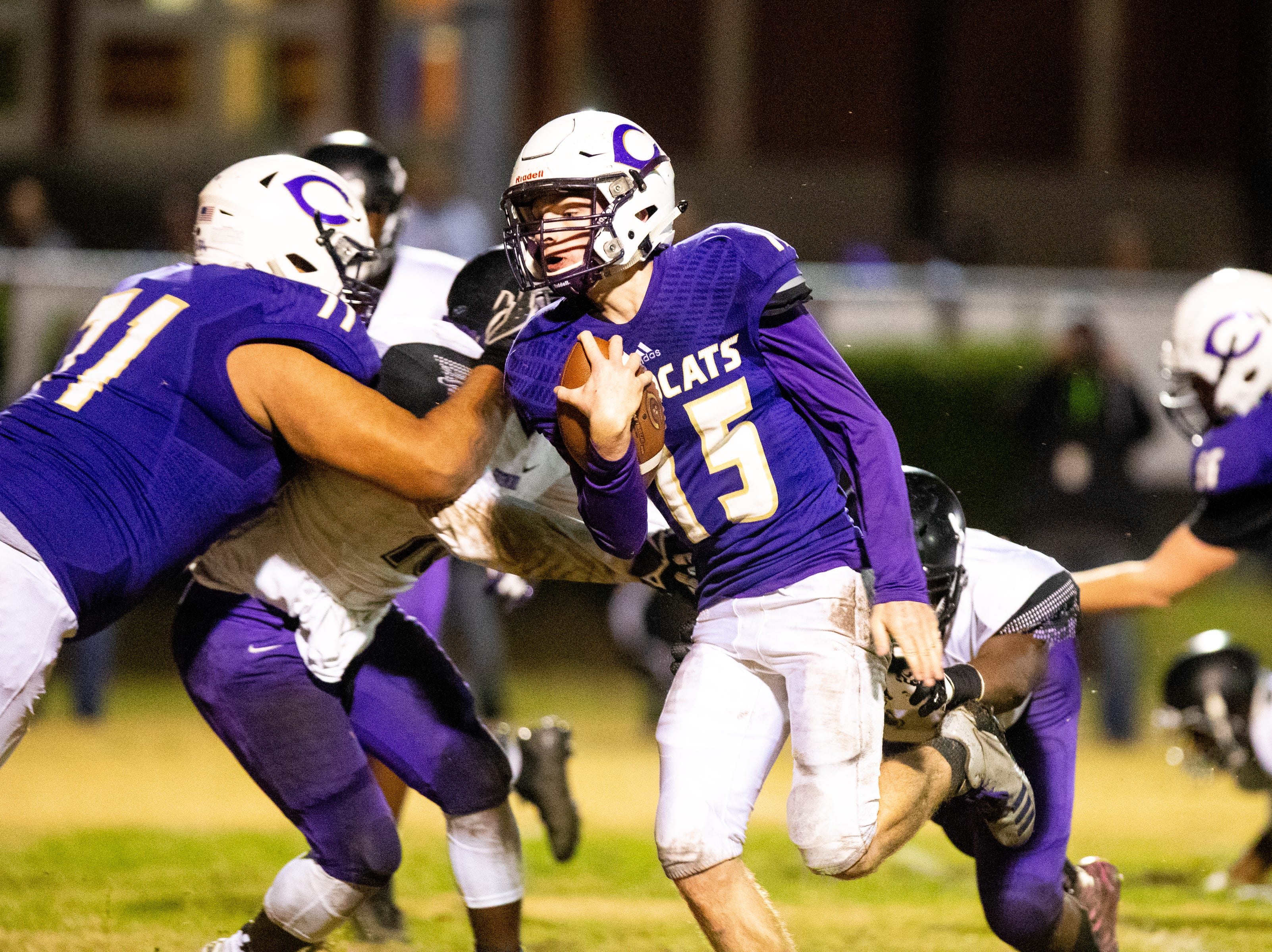 Backup quarterback Colby Cook (15) of Clarksville High runs the ball for a touchdown during the second half at Clarksville High Friday, Nov. 2, 2018, in Clarksville, Tenn.
