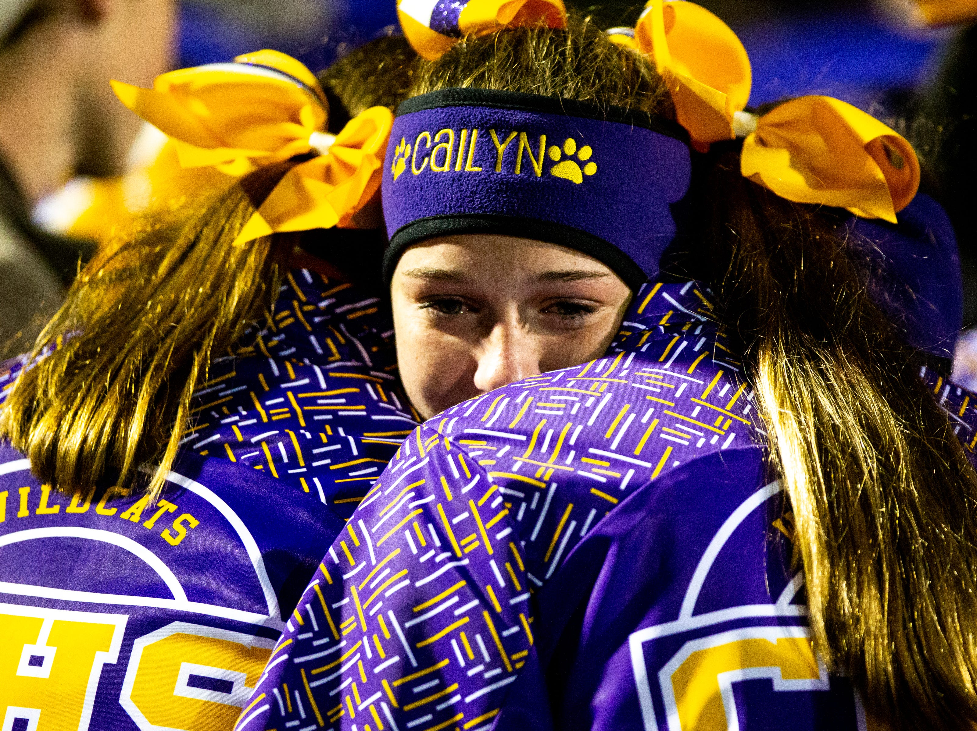 Clarksville High cheerleaders comfort each other after losing in overtime at Clarksville High Friday, Nov. 2, 2018, in Clarksville, Tenn.