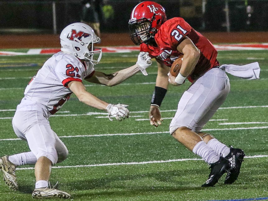 Hunterdon Central's Terence Murphy (right) spins out of the grasp of Manalapan's John Scharaldi during a Central Group V first round game on Friday, Nov. 2, 2018.