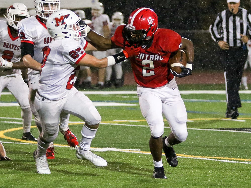 Hunterdon Central's Will Ezema (2) tries to hold off Manalapan's Anthony Matrone (27) during a Central Group V first round game on Friday, Nov. 2, 2018.