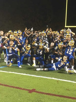 The North Brunswick football players celebrate their playoff win over Trenton in Central Group V on Friday, Nov. 2, 2018.