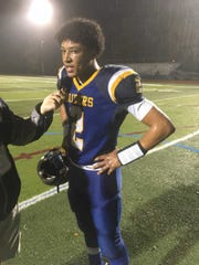 North Brunswick's Myles Bailey gets interviewed after his team's playoff win over Trenton in Central Group V on Friday, Nov. 2, 2018.