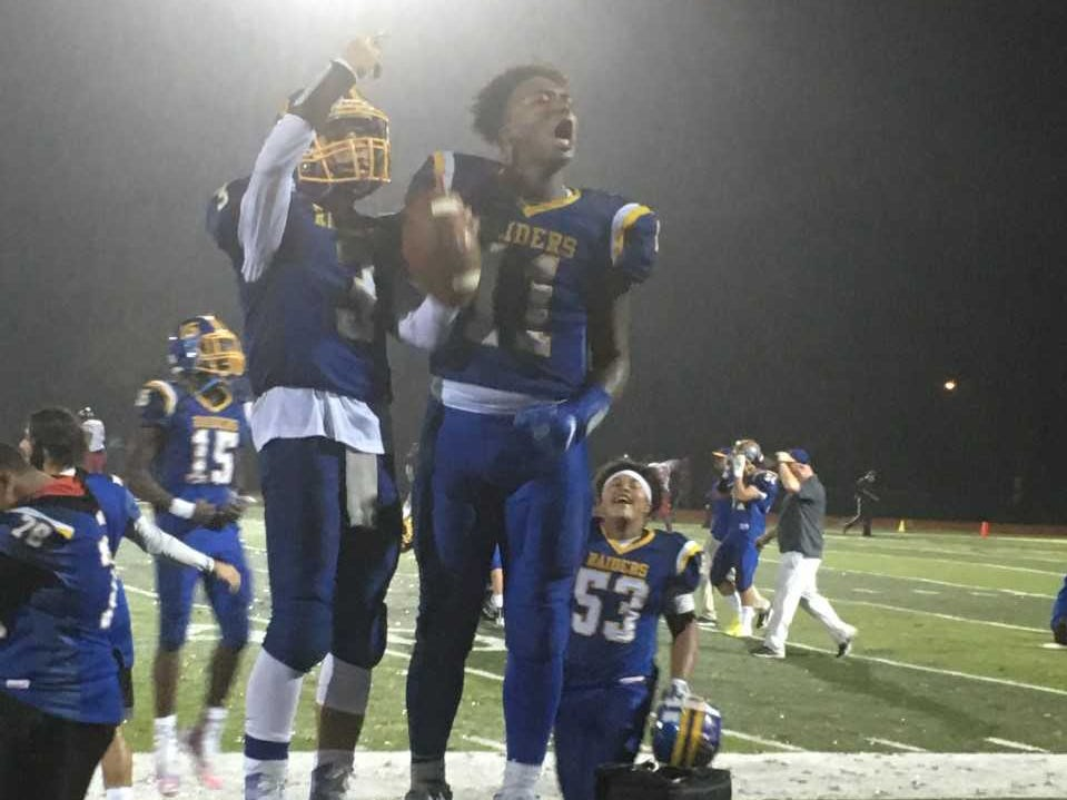 North Brunswick's Christian Petrillo and Chris Arnold celebrate their win over Trenton in the Central Group V first round on Friday, Nov. 2, 2018.