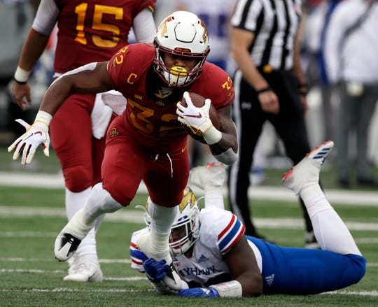 Iowa State running back David Montgomery (32) is tackled by Kansas defensive end Brian Lipscomb, back, during the first half of an NCAA college football game in Lawrence, Kan., Saturday, Nov. 3, 2018.