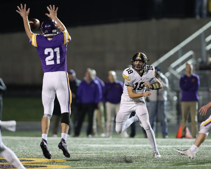 Nov 2, 2018; Johnston, IA, USA; Johnston Dragons Nathan Newcomb (21) knocks down the pass from Southeast Polk Rams Josiah Cole (18) at Johnston Stadium. The Rams beat the Dragons 21-7.