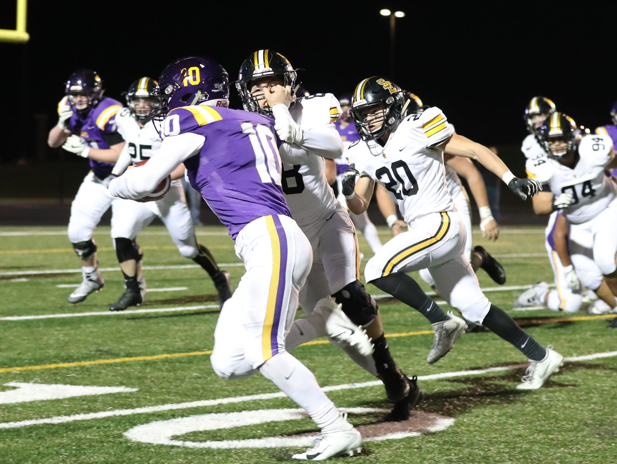 Nov 2, 2018; Johnston, IA, USA; Johnston Dragons Andrew Nord (10) is called for a facemark agains the Southeast Polk Rams  at Johnston Stadium. The Rams beat the Dragons 21-7.