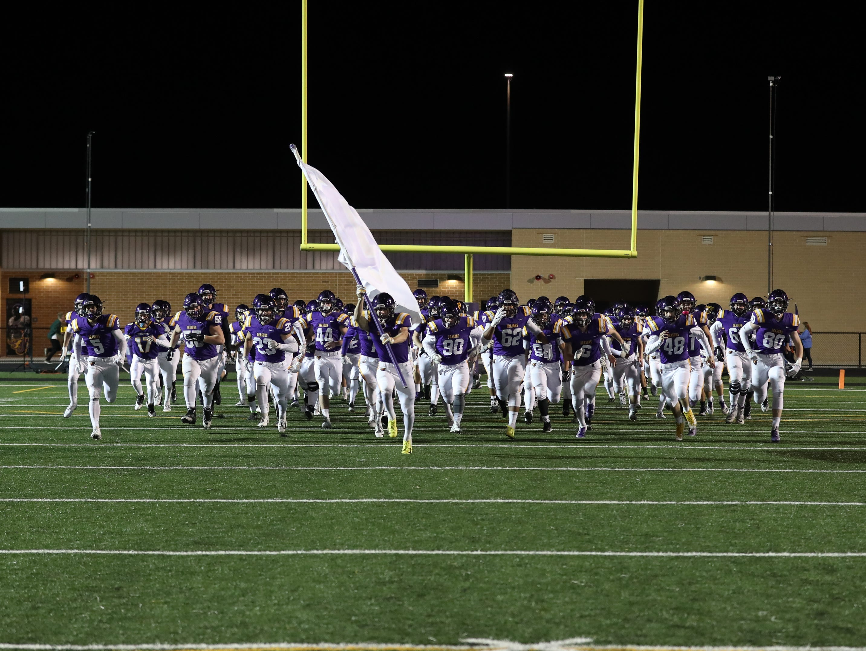 Nov 2, 2018; Johnston, IA, USA; Johnston Dragons enter the field before their game against the Southeast Polk Rams at Johnston Stadium. The Rams beat the Dragons 21-7.