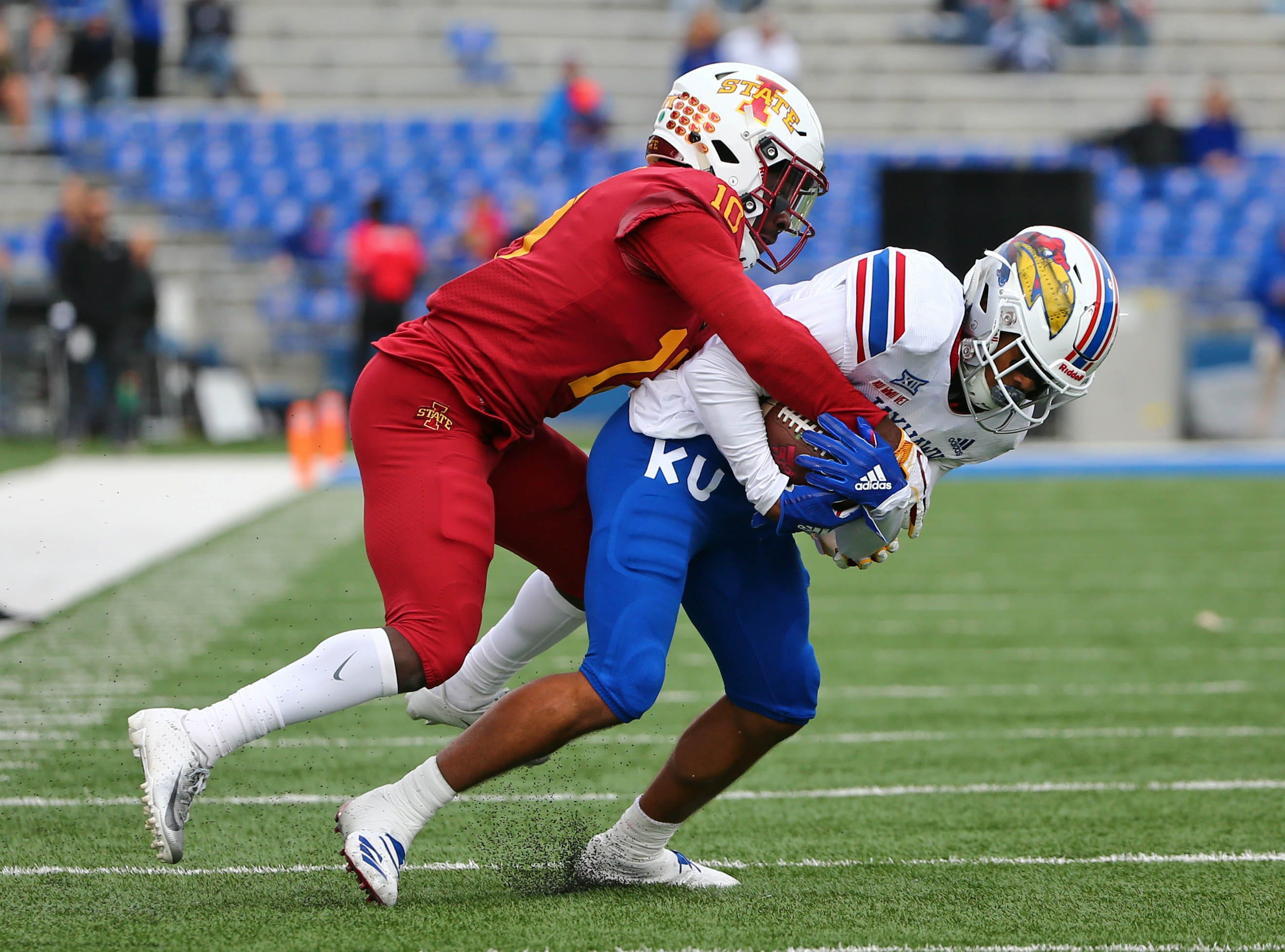 Nov 3, 2018; Lawrence, KS, USA; Iowa State Cyclones defensive back Brian Peavy (10) strips the ball from Kansas Jayhawks wide receiver Stephon Robinson (5) in the first half at Memorial Stadium.