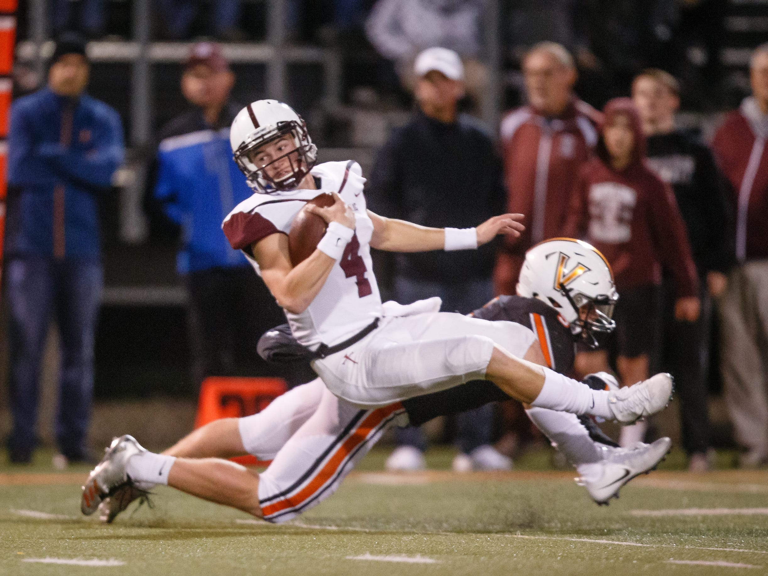 Dowling Catholic's Zach Watters (4) is tackled during their football playoff game against Valley on Friday, Nov. 2, 2018, in West Des Moines. Dowling takes a 17-06 lead into halftime.