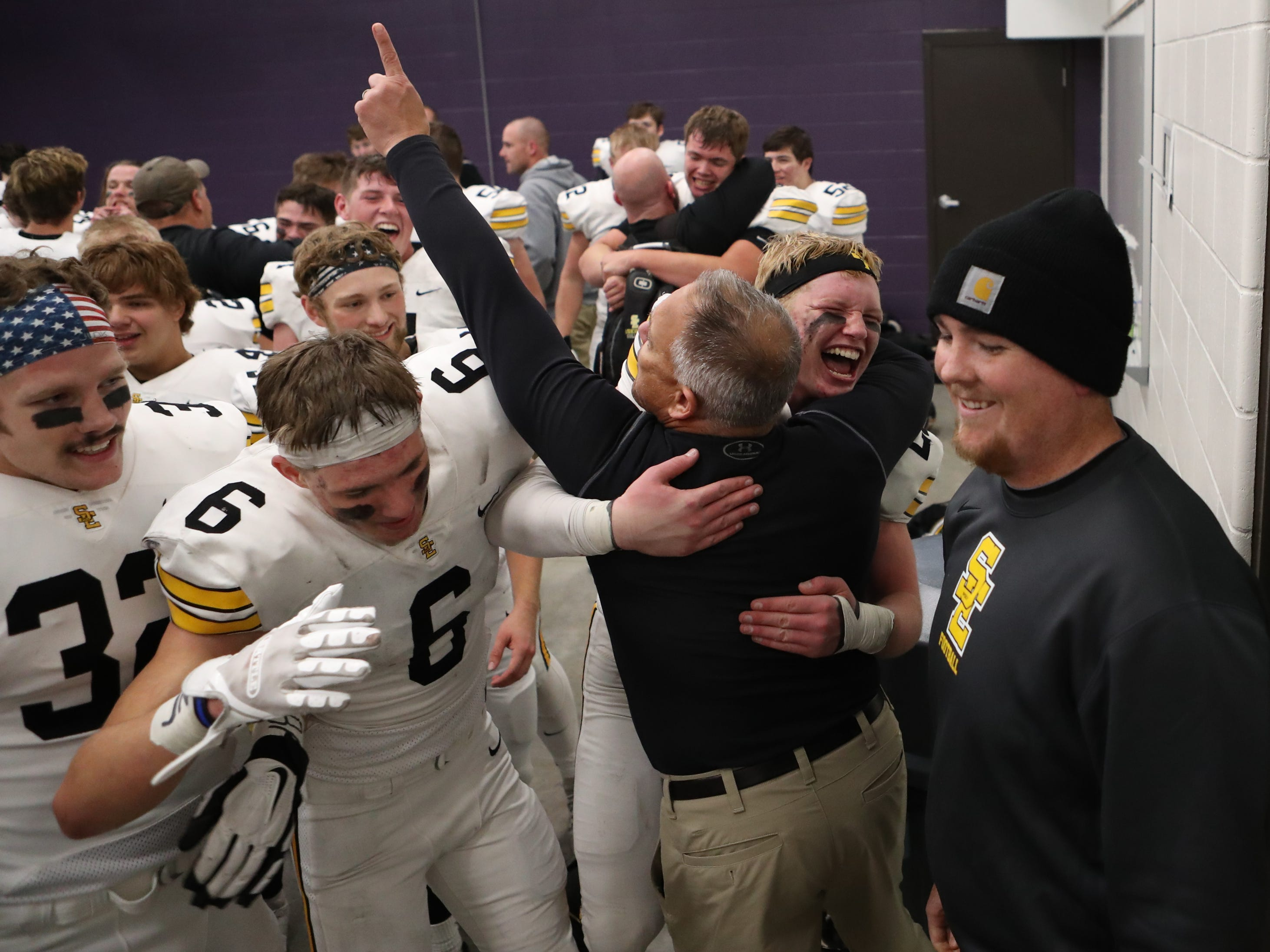 Nov 2, 2018; Johnston, IA, USA; Southeast Polk Rams coach Mark Martin celebrates with the defense after their win against the Dragons at Johnston Stadium. The Rams beat the Dragons 21-7.